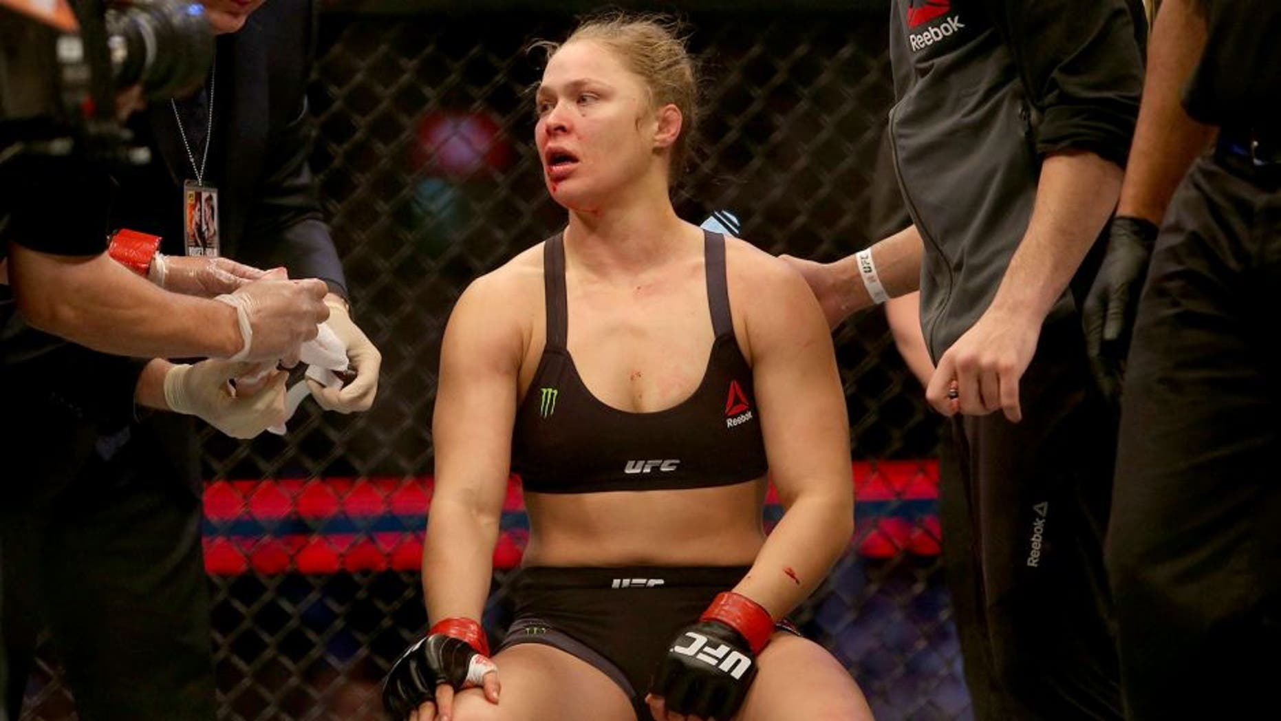 MELBOURNE, AUSTRALIA - NOVEMBER 15: Ronda Rousey of the United States receives medical treatment after being defeated by Holly Holm of the United States in their UFC women's bantamweight championship bout during the UFC 193 event at Etihad Stadium on November 15, 2015 in Melbourne, Australia. (Photo by Pat Scala /Zuffa LLC/Zuffa LLC via Getty Images)