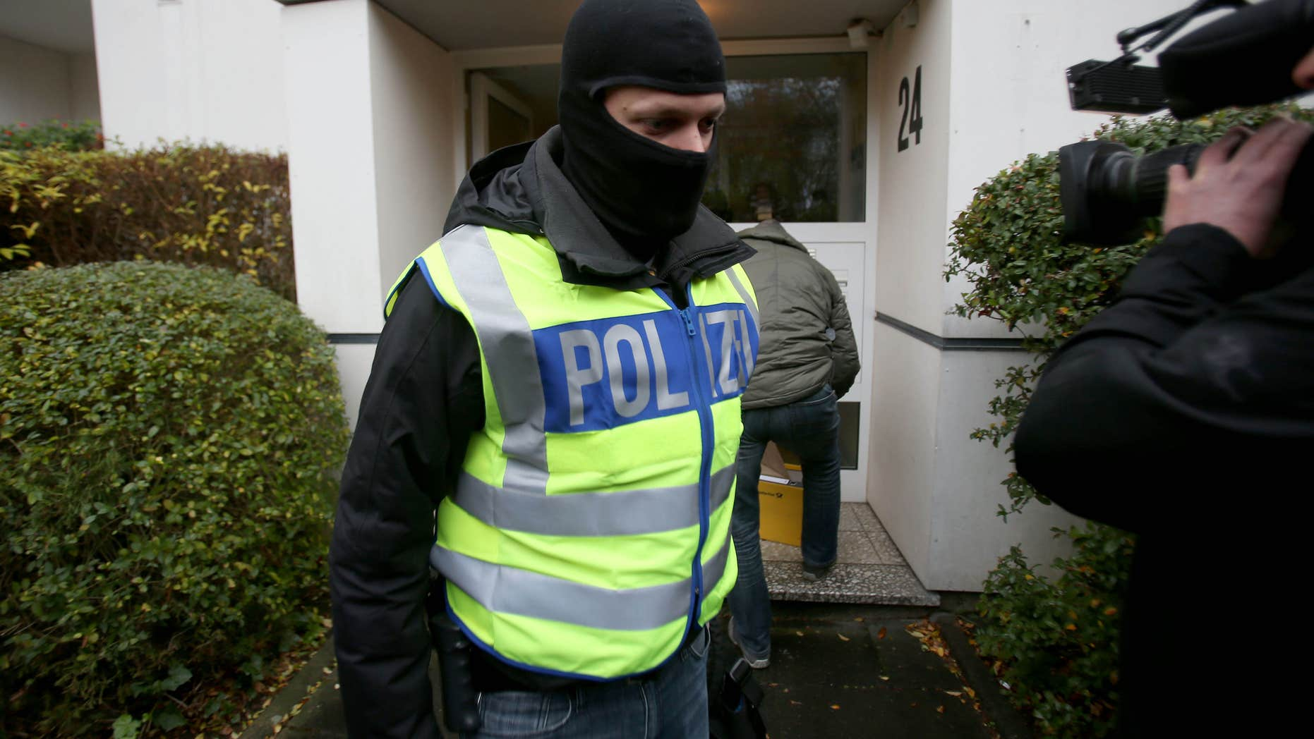Nov. 15, 2016: Police officers leave a residential house which has been searched in Bonn, western Germany.