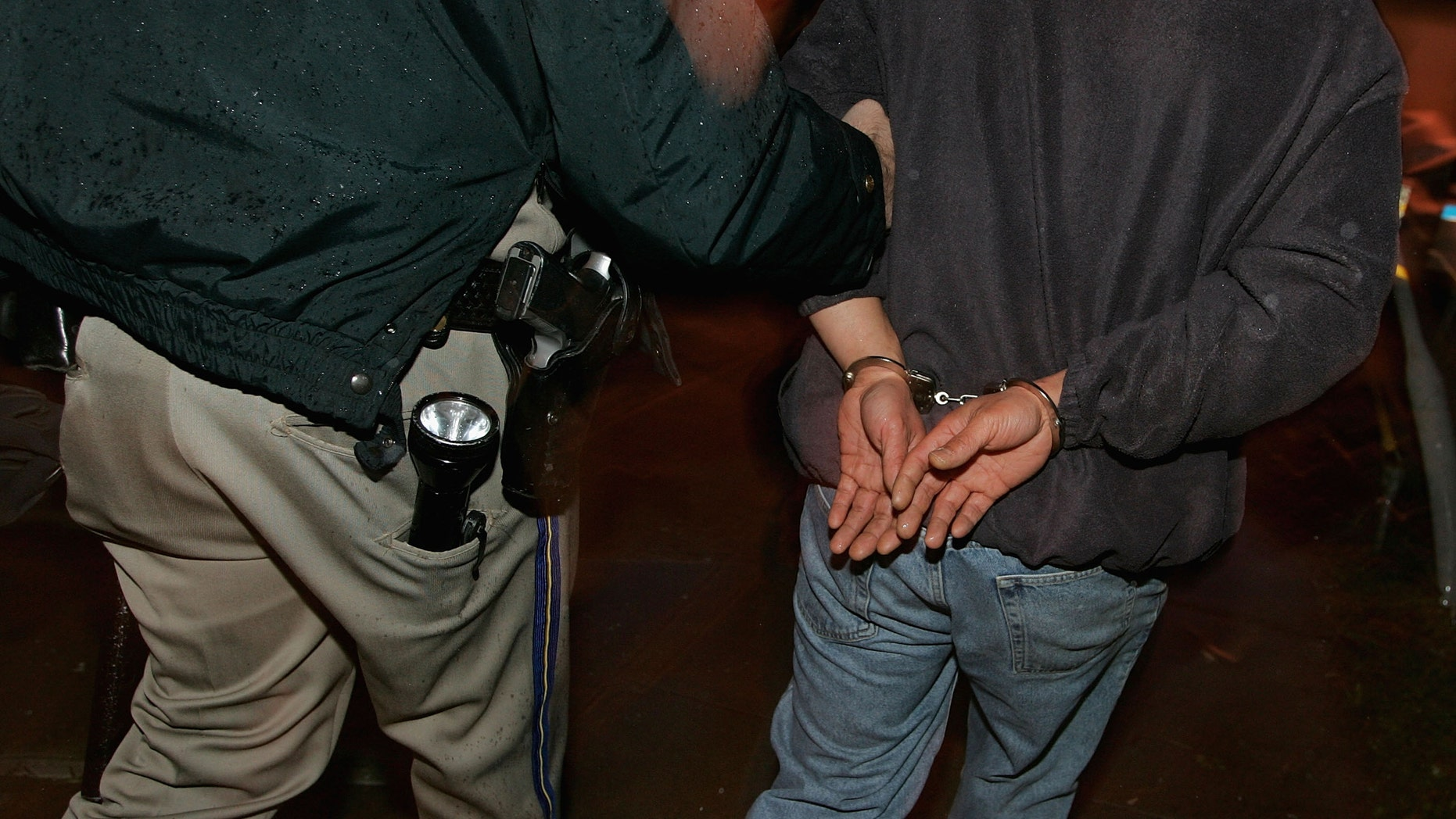 SAN FRANCISCO - DECEMBER 26: A man is taken away in handcuffs after failing a sobriety test at a sobriety checkpoint December 26, 2004 in San Francisco, California. The California Highway Patrol reported a total of 1,481  driving under the influence arrests since the December 17 the start of the AVOID regional campaign against drunken driving. AVOID, a regional force of 125 police departments in the San Francisco Bay Area, runs its annual ANTI-DUI campaign from December 17 through January 2.  (Photo by Justin Sullivan/Getty Images)