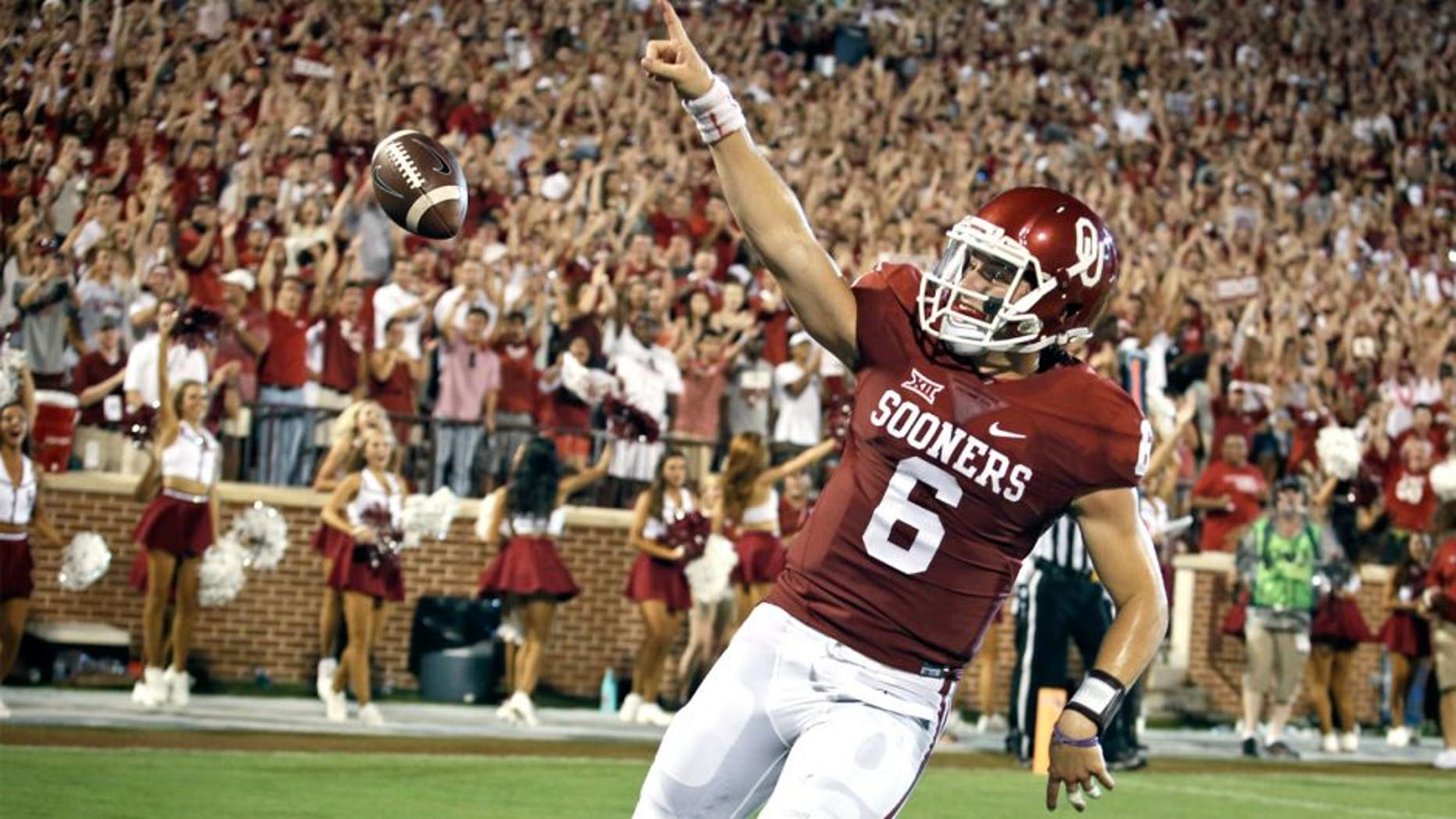NORMAN, OK - SEPTEMBER 5: Quarterback Baker Mayfield #6 of the Oklahoma Sooners celebrates a touchdown against the Akron Zips September 5, 2015 at Gaylord Family-Oklahoma Memorial Stadium in Norman, Oklahoma. Oklahoma defeated Akron 41-3.(Photo by Brett Deering/Getty Images)
