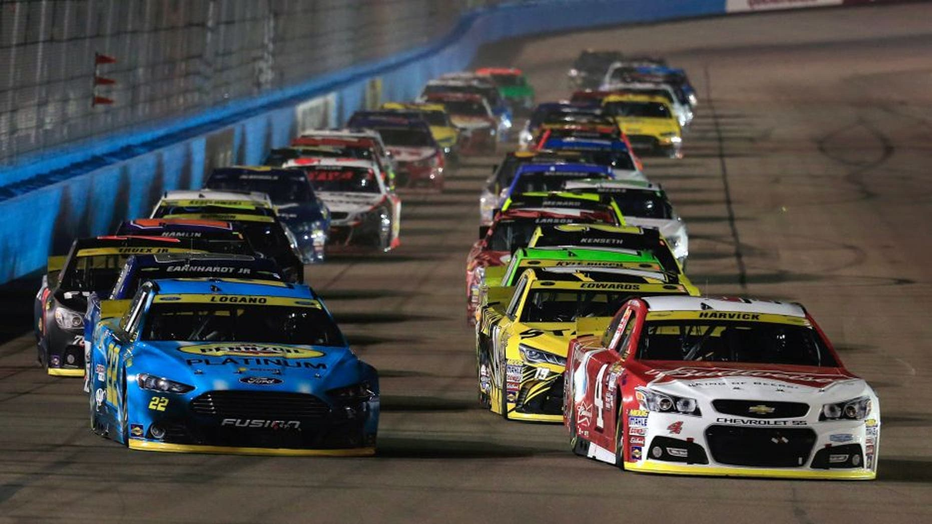 AVONDALE, AZ - NOVEMBER 15: Kurt Busch, driver of the #41 Haas Automation Chevrolet, and Joey Logano, driver of the #22 Pennzoil Ford, lead the field during the NASCAR Sprint Cup Series Quicken Loans Race for Heroes 500 at Phoenix International Raceway on November 15, 2015 in Avondale, Arizona. (Photo by Chris Trotman/Getty Images)