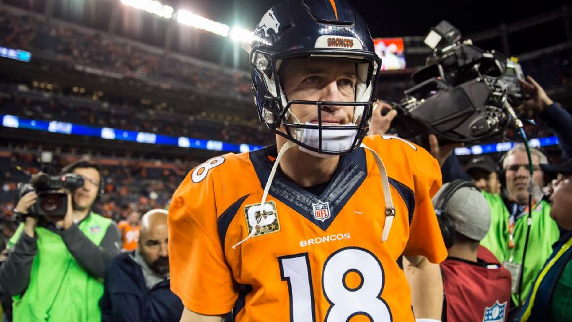Denver Broncos quarterback Peyton Manning (18) walks off the field after throwing four interceptions and being replaced by Denver Broncos quarterback Brock Osweiler in the 29-13 loss to the Kansas City Chiefs on Sunday, Nov. 15, 2015, at Sports Authority Field at Mile High Stadium in Denver. (David Eulitt/Kansas City Star/TNS via Getty Images)