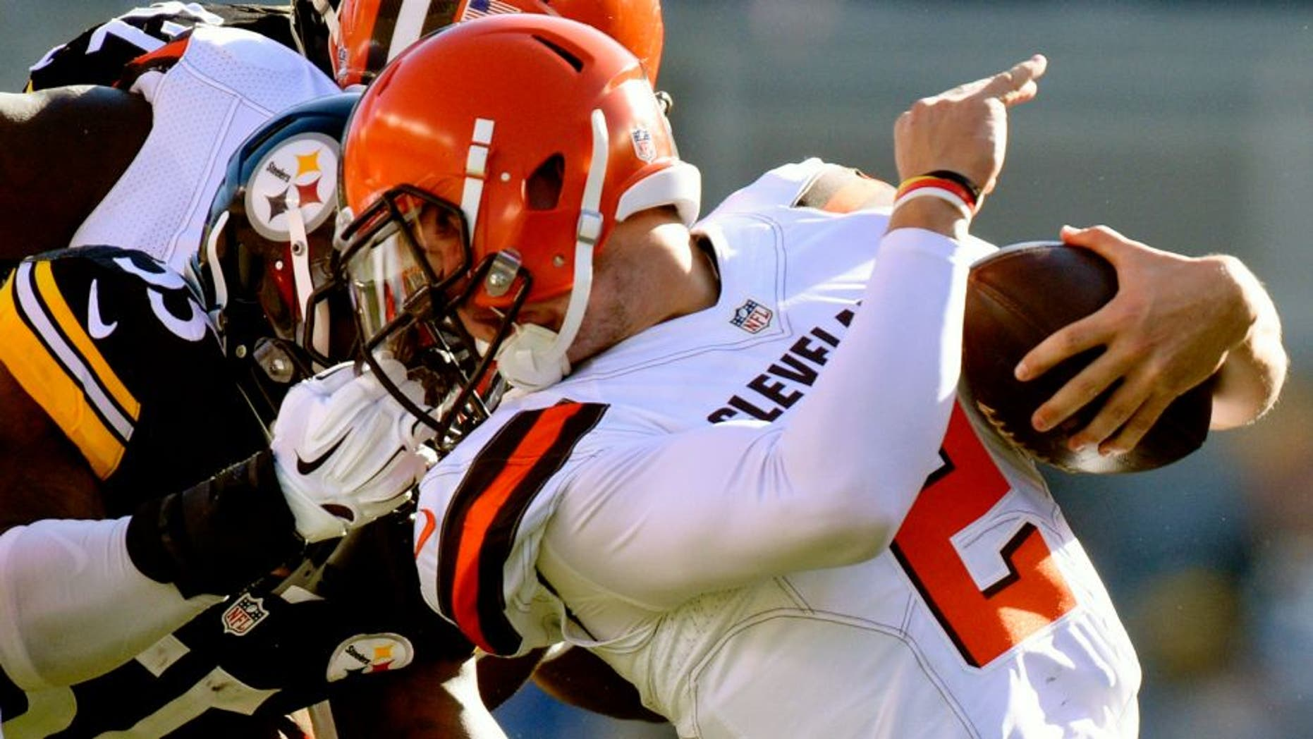 Cleveland Browns quarterback Johnny Manziel (2) is tackled by the face mask by Pittsburgh Steelers outside linebacker Arthur Moats (55) in the second quarter of an NFL football game, Sunday, Nov. 15, 2015, in Pittsburgh. Moats was penalized on the play. (AP Photo/Don Wright)