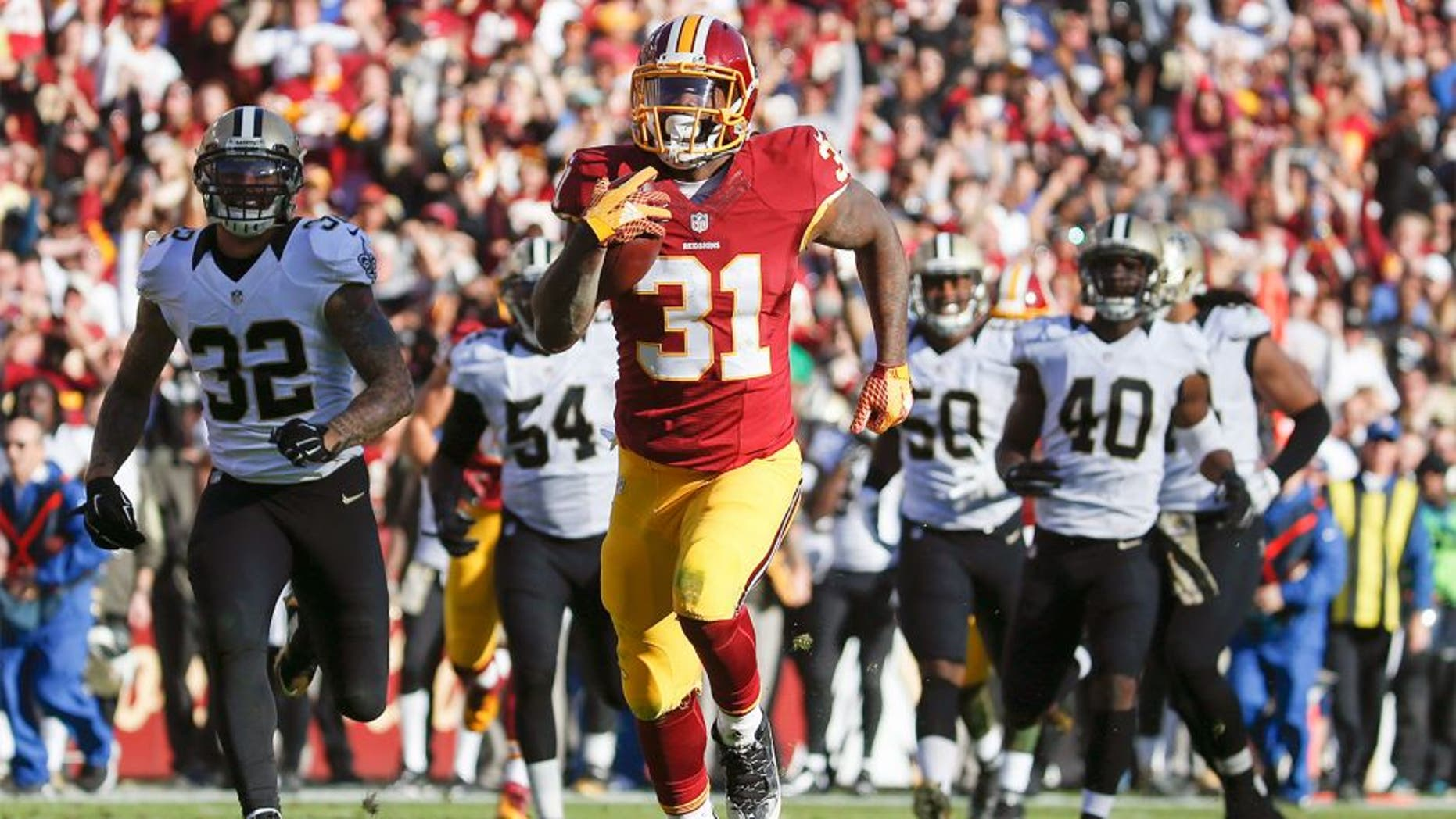 Washington Redskins running back Matt Jones (31) outpaces the New Orleans Saints defense to score a 78 yard touchdown during the first half of an NFL football game in Landover, Md., Sunday, Nov. 15, 2015. (AP Photo/Evan Vucci)