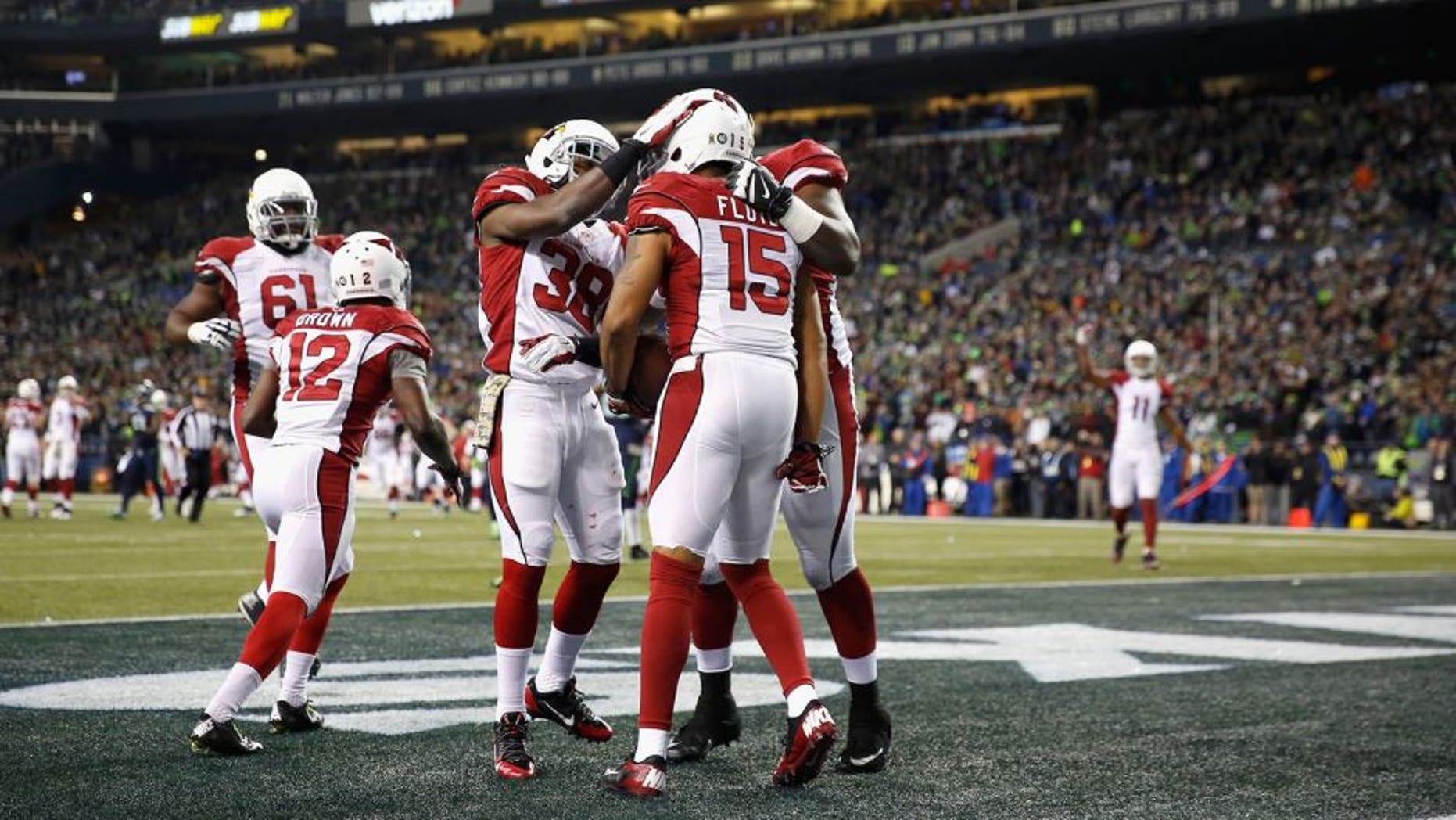 SEATTLE, WA - NOVEMBER 15: Michael Floyd #15 of the Arizona Cardinals celebrates with teammates in the end zone after scoring a touchdown during the second quarter against the Seattle Seahawks at CenturyLink Field on November 15, 2015 in Seattle, Washington. (Photo by Otto Greule Jr/Getty Images)