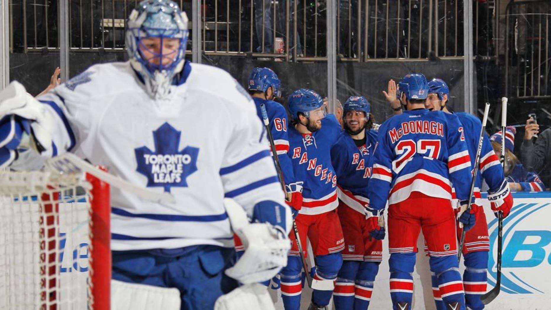 NEW YORK, NY - NOVEMBER 15: Mats Zuccarello #36, Derick Brassard #16, Rick Nash #61, Ryan McDonagh #27 and Dan Girardi #5 of the New York Rangers celebrate after scoring in the third period against Jonathan Bernier #45 of the Toronto Maple Leafs at Madison Square Garden on November 15, 2015 in New York City. (Photo by Jared Silber/NHLI via Getty Images)