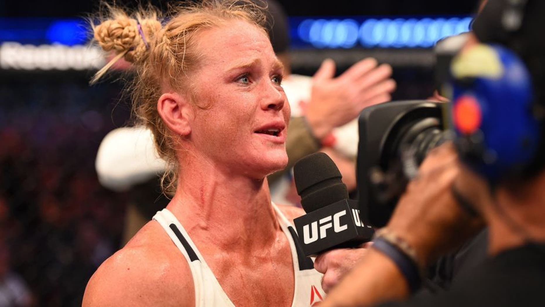 MELBOURNE, AUSTRALIA - NOVEMBER 15: Holly Holm is interviewed by Joe Rogan after her second round KO (head kick and punches) against Ronda Rousey (not pictured) to win their UFC women's bantamweight championship bout during the UFC 193 event at Etihad Stadium on November 15, 2015 in Melbourne, Australia. (Photo by Josh Hedges/Zuffa LLC/Zuffa LLC via Getty Images)
