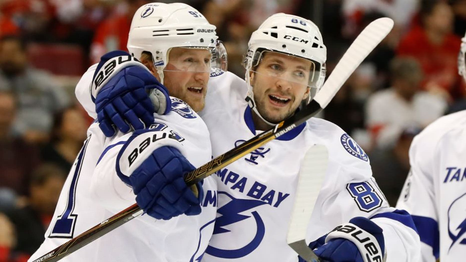 Tampa Bay Lightning center Steven Stamkos, left, celebrates his goal against the Detroit Red Wings with Nikita Kucherov in the first period of an NHL hockey game Tuesday, Nov. 15, 2016 in Detroit. (AP Photo/Paul Sancya)