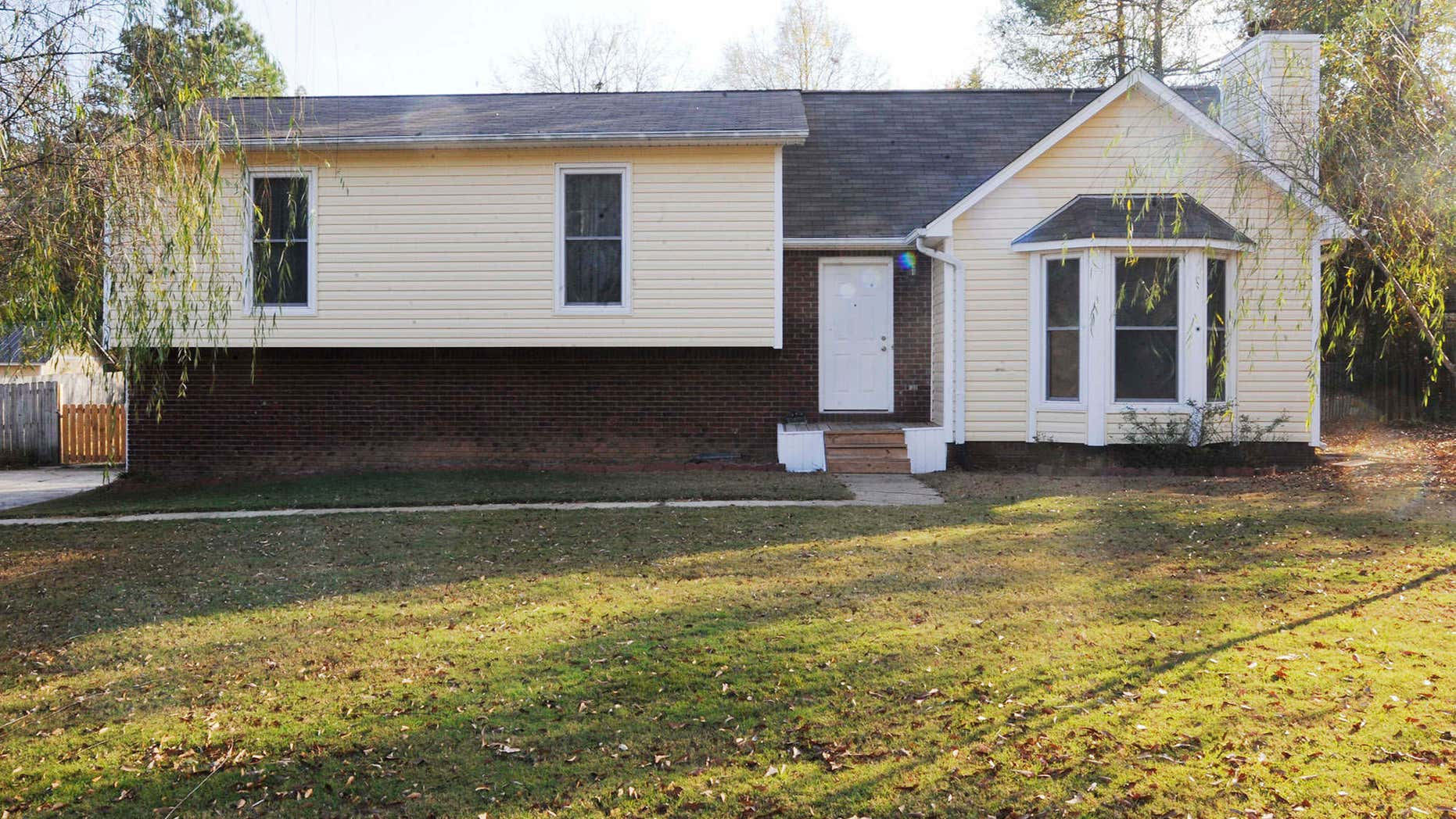 The suburban home where police say a 14-year-old boy was held for most of two years in the basement is shown on Tuesday, Nov. 15, 2016, in Helena, Ala.