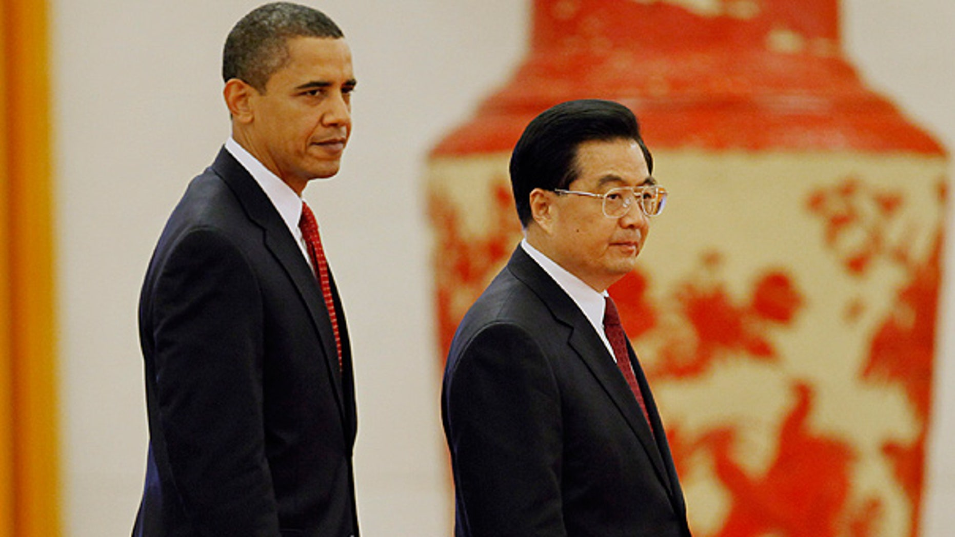Nov. 17, 2010: President Obama walks with Chinese President Hu Jintao during a welcome ceremony at the Great Hall of the People in Beijing.