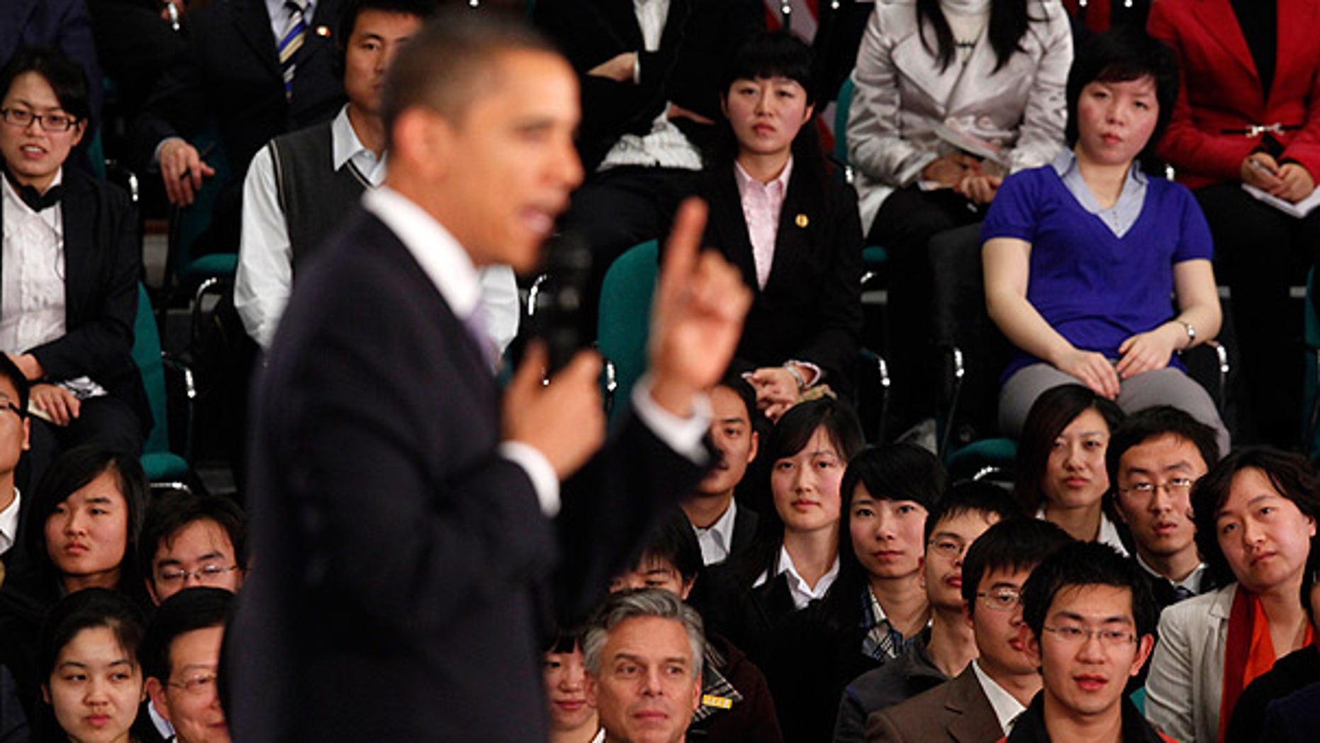 Nov. 16: Audience members listen as President Obama speaks at a town hall style event with Chinese youth at the Museum of Science and Technology in Shanghai. (AP)