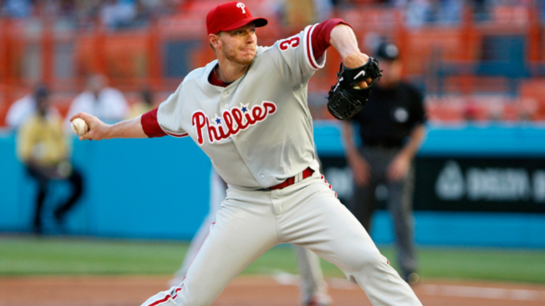 This May 29, 2010, file photo shows Philadelphia Phillies' Roy Halladay throwing a pitch during the first inning, enroute to a perfect game, against the Florida Marlins, in Miami.