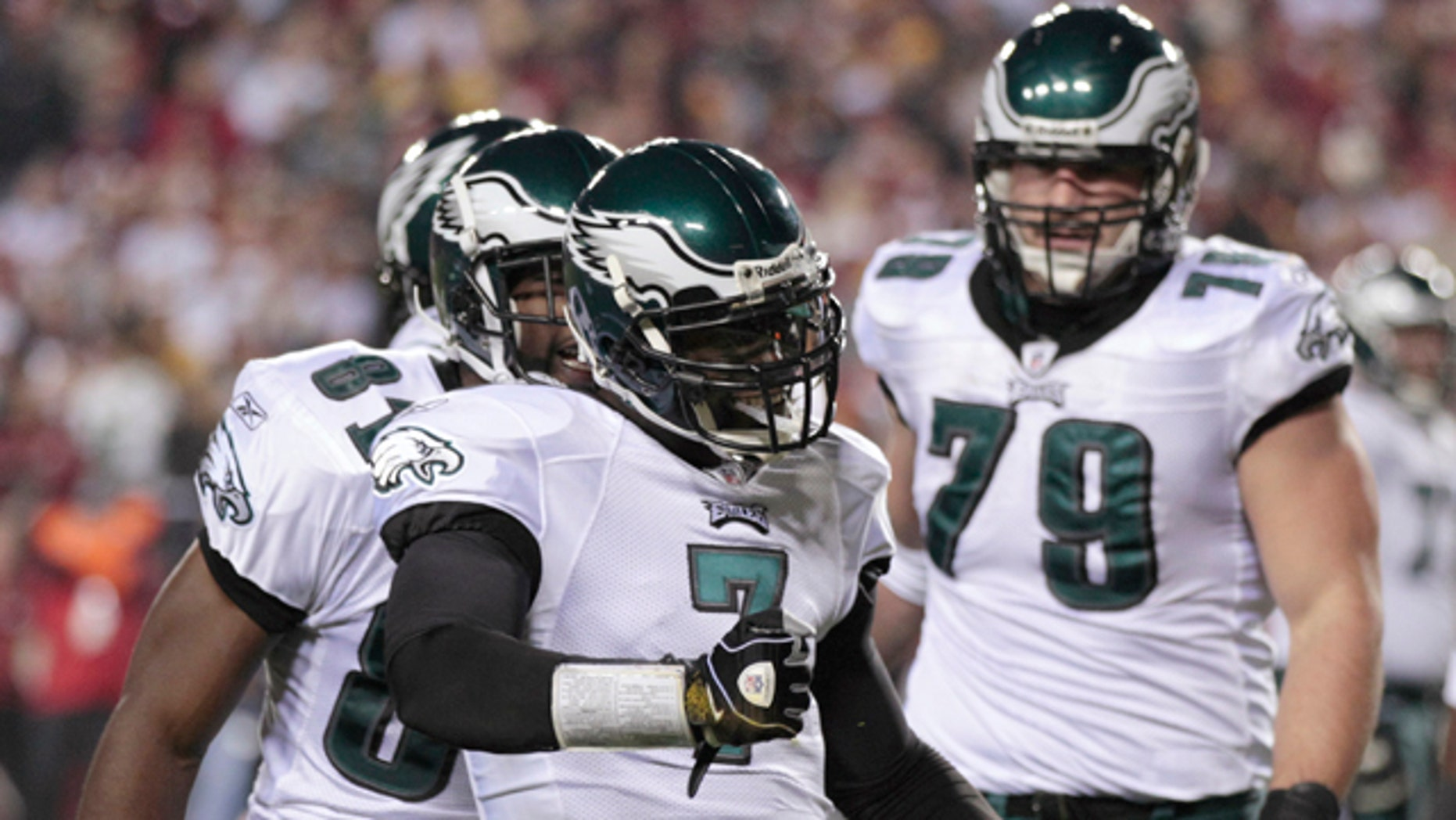 Nov. 15: Philadelphia Eagles quarterback Michael Vick (7) celebrates after scoring a rushing touchdown against the Washington Redskins during the first half of an NFL football game in Landover, Md.