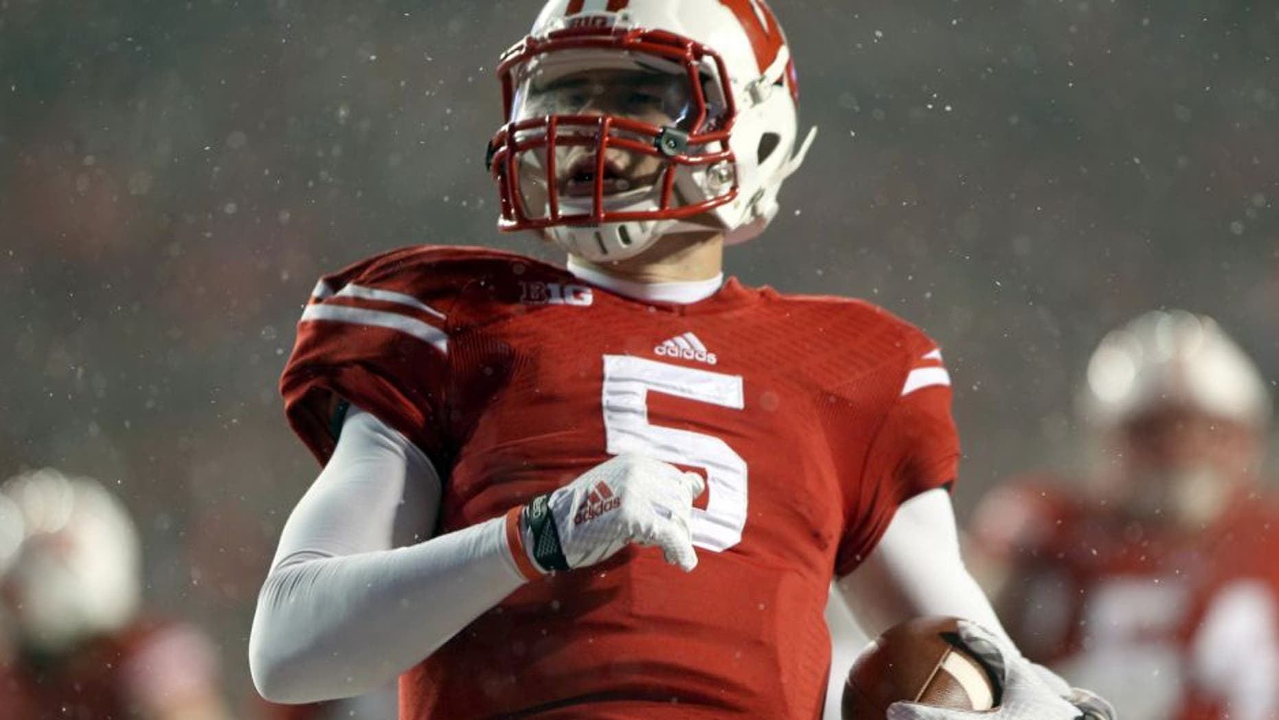 Nov 15, 2014; Madison, WI, USA; Wisconsin Badgers quarterback Tanner McEvoy (5) scores a touchdown during the game with the Nebraska Cornhuskers at Camp Randall Stadium. Wisconsin defeated Nebraska 59-24. Mandatory Credit: Mary Langenfeld-USA TODAY Sports
