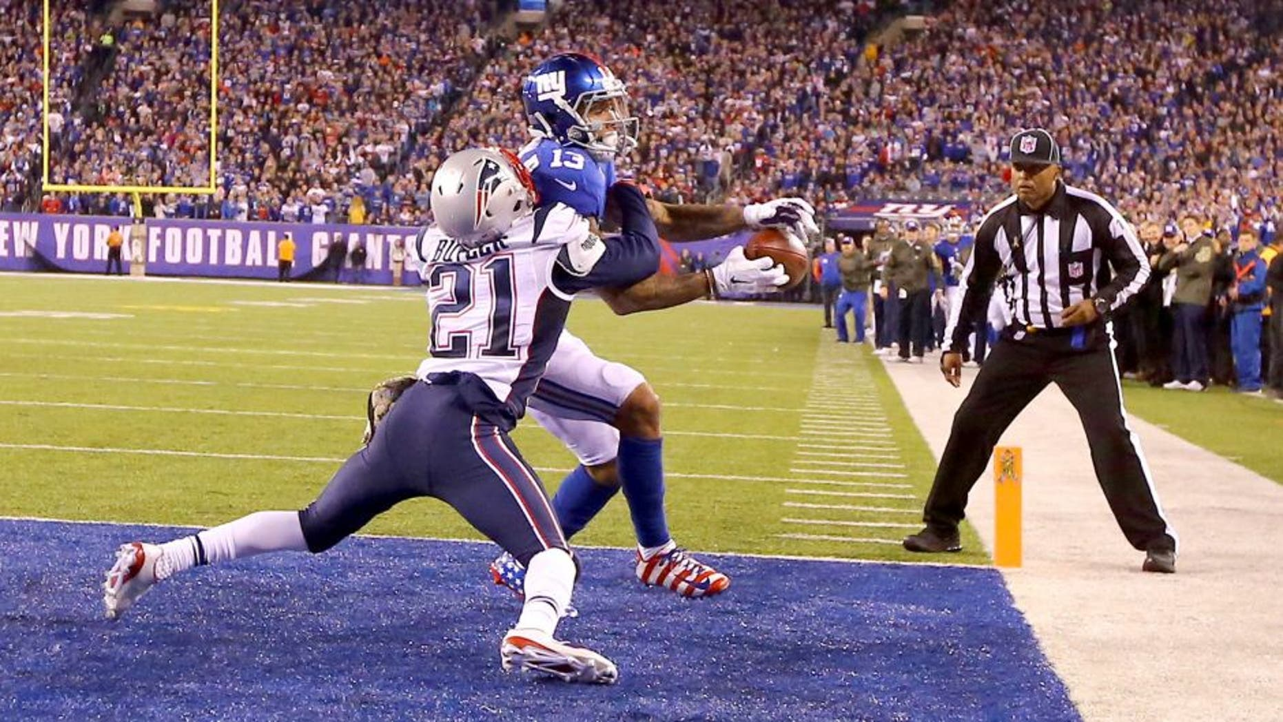 EAST RUTHERFORD, NJ - NOVEMBER 15: Odell Beckham #13 of the New York Giants cannot hold onto the ball which is broken up in the end zone by Malcolm Butler #21 of the New England Patriots in the fourth Quarter during their game at MetLife Stadium on November 15, 2015 in East Rutherford, New Jersey. (Photo by Al Bello/Getty Images)