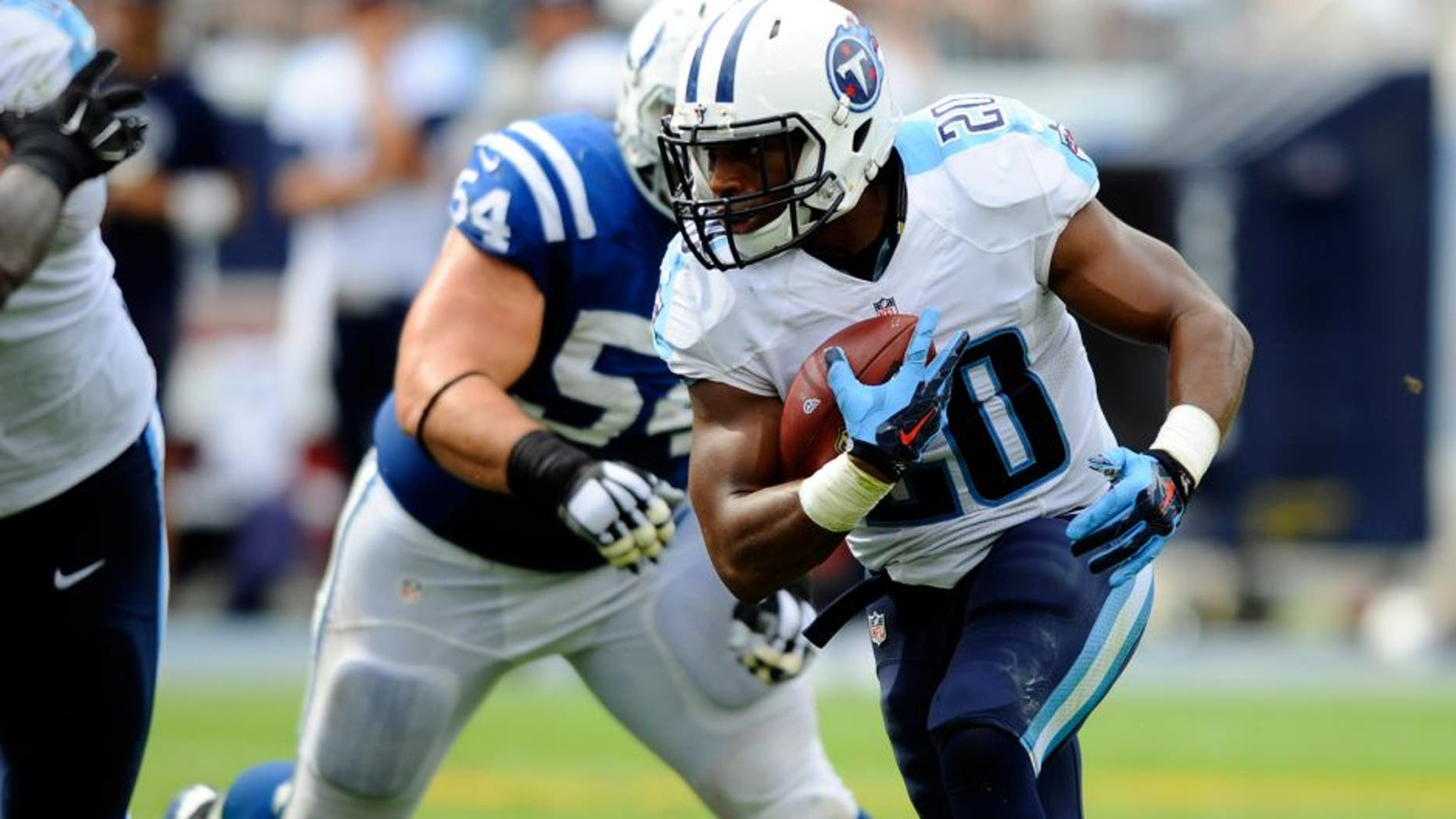 Sep 27, 2015; Nashville, TN, USA; Tennessee Titans running back Bishop Sankey (20) runs for a short gain during the second half against the Indianapolis Colts at Nissan Stadium. The Colts won 35-33. Mandatory Credit: Christopher Hanewinckel-USA TODAY Sports