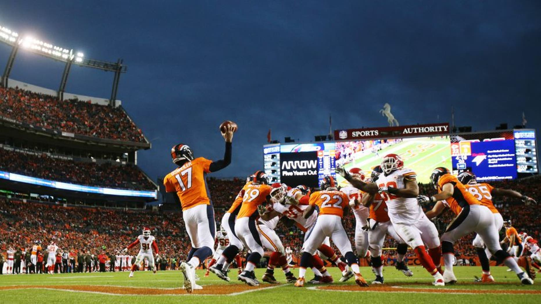 Nov 15, 2015; Denver, CO, USA; Denver Broncos quarterback Brock Osweiler (17) throws a pass during the second half against the Kansas City Chiefs at Sports Authority Field at Mile High. The Chiefs won 29-13. Mandatory Credit: Chris Humphreys-USA TODAY Sports