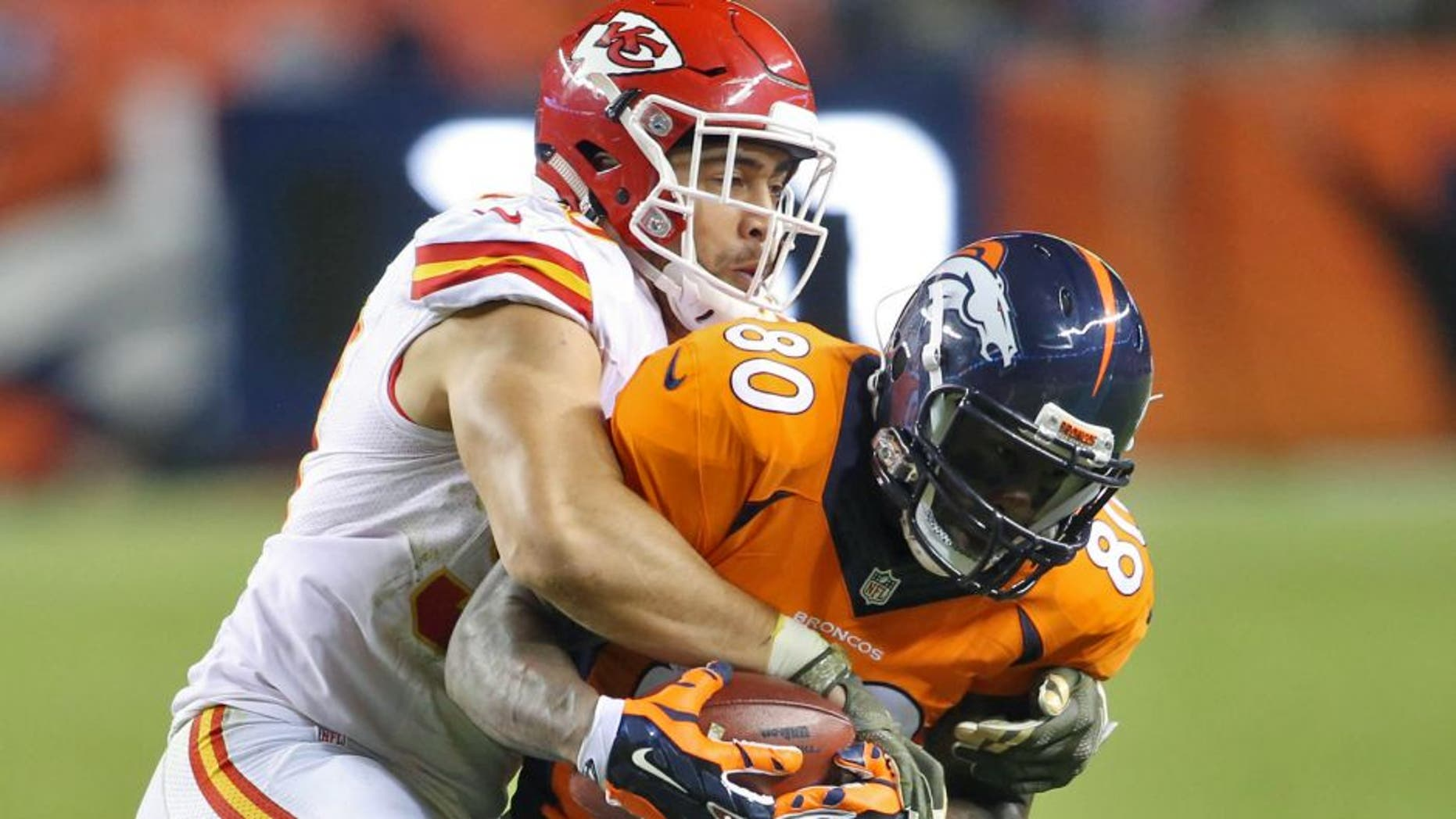 Nov 15, 2015; Denver, CO, USA; Denver Broncos tight end Vernon Davis (80) is brought down by Kansas City Chiefs inside linebacker Josh Mauga (90) during the second half at Sports Authority Field at Mile High. The Chiefs won 29-13. Mandatory Credit: Chris Humphreys-USA TODAY Sports