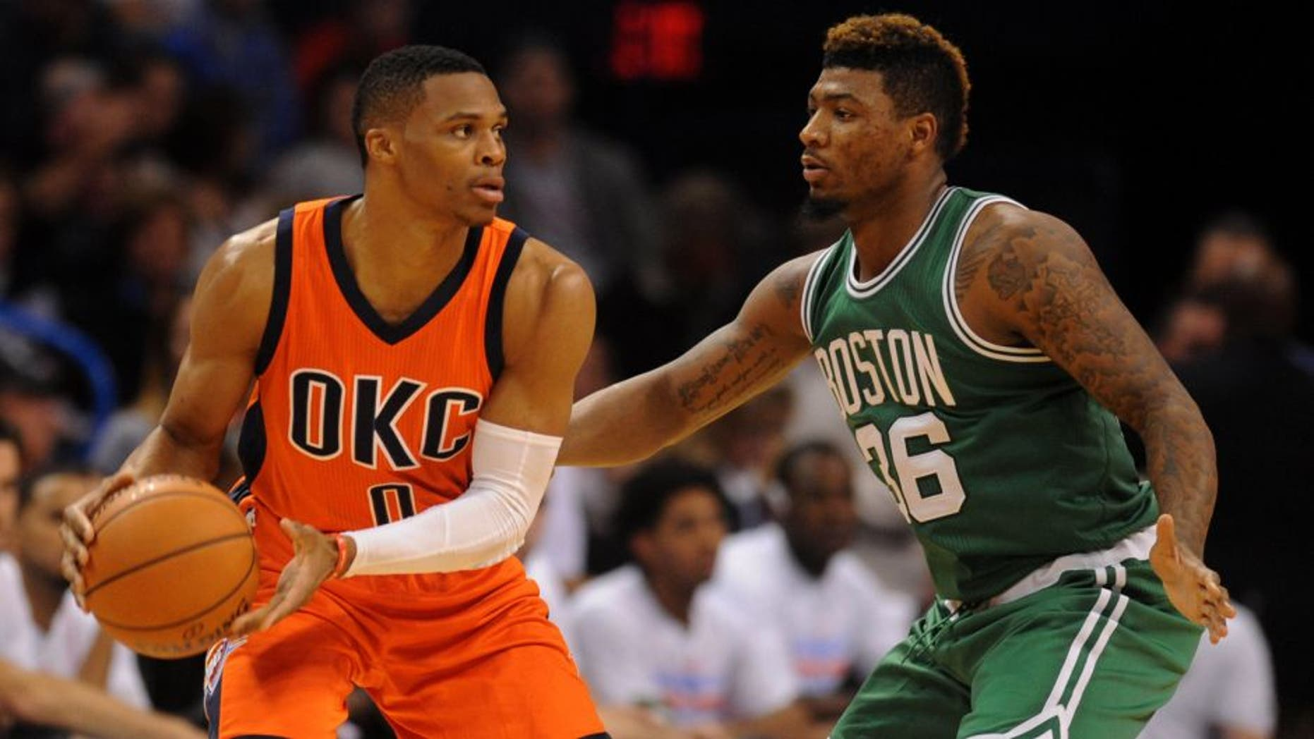 Nov 15, 2015; Oklahoma City, OK, USA; Oklahoma City Thunder guard Russell Westbrook (0) handles the ball while being guarded by Boston Celtics guard Marcus Smart (36) during the third quarter at Chesapeake Energy Arena. Mandatory Credit: Mark D. Smith-USA TODAY Sports