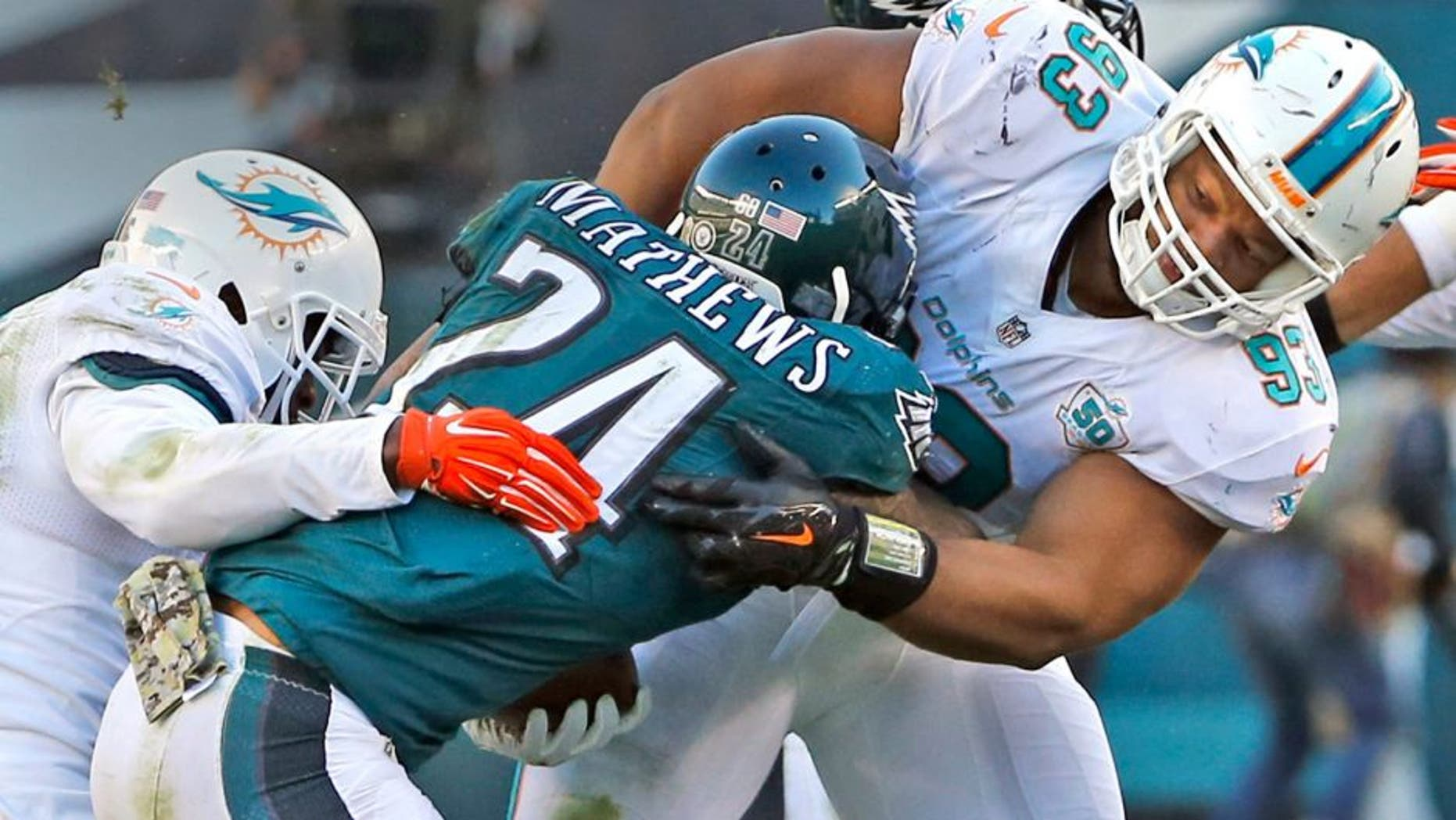 Miami Dolphins' Reshad Jones and Ndamukong Suh tackle Philadelphia Eagles' Ryan Mathews during the third quarter on Sunday, Nov. 15, 2015, at Lincoln Financial Field in Philadelphia. (Charles Trainor Jr./Miami Herald/TNS via Getty Images)