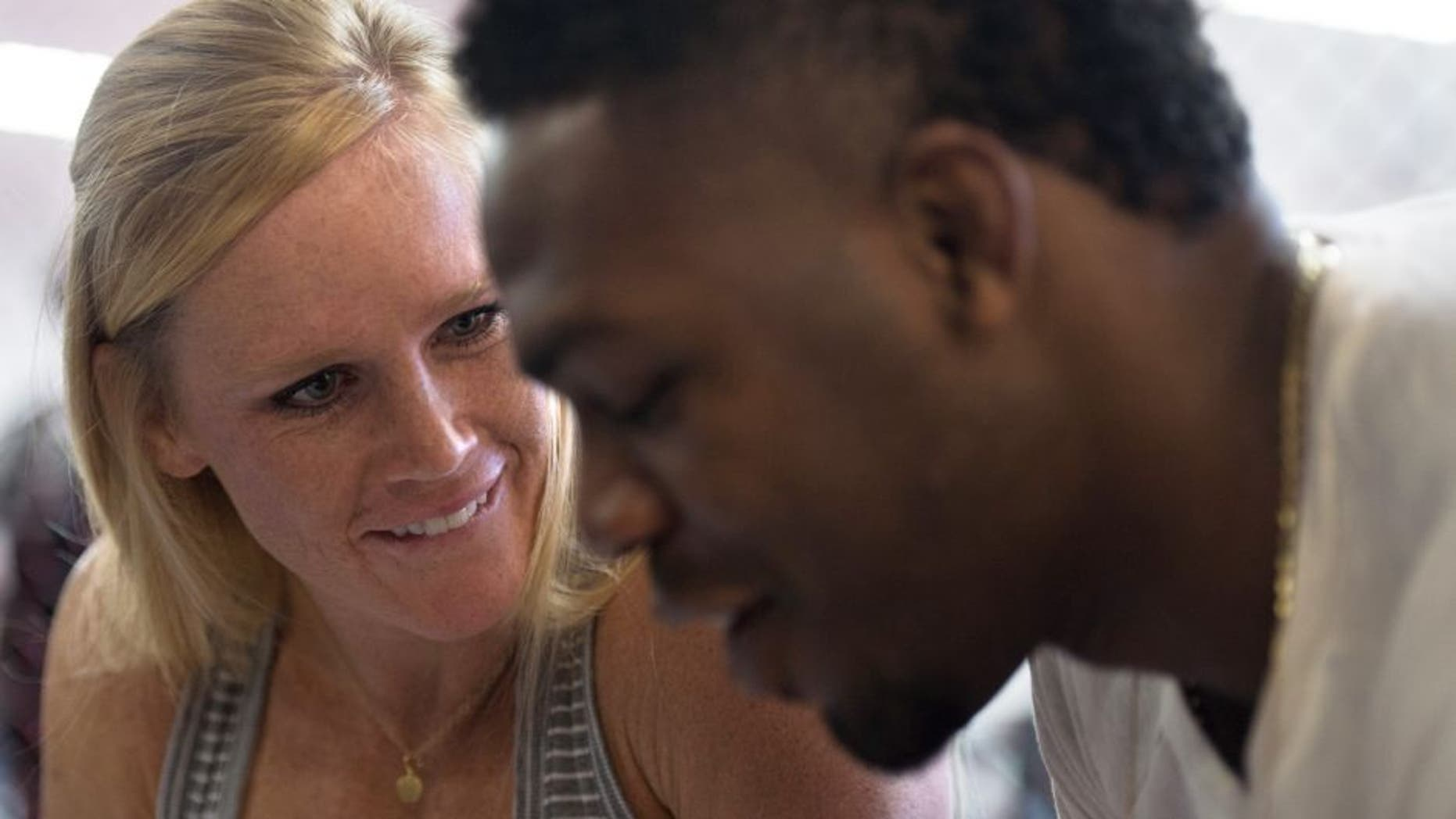 ALBUQUERQUE, NM - OCTOBER 31: (L-R) Holly Holm and Jon Jones sign autographs for fans during the Jackson Wink MMA Academy Grand Opening at Jackson's Mixed Martial Arts & Fitness on October 31, 2015 in Albuquerque, New Mexico. (Photo by Brandon Magnus/Zuffa LLC/Zuffa LLC via Getty Images)