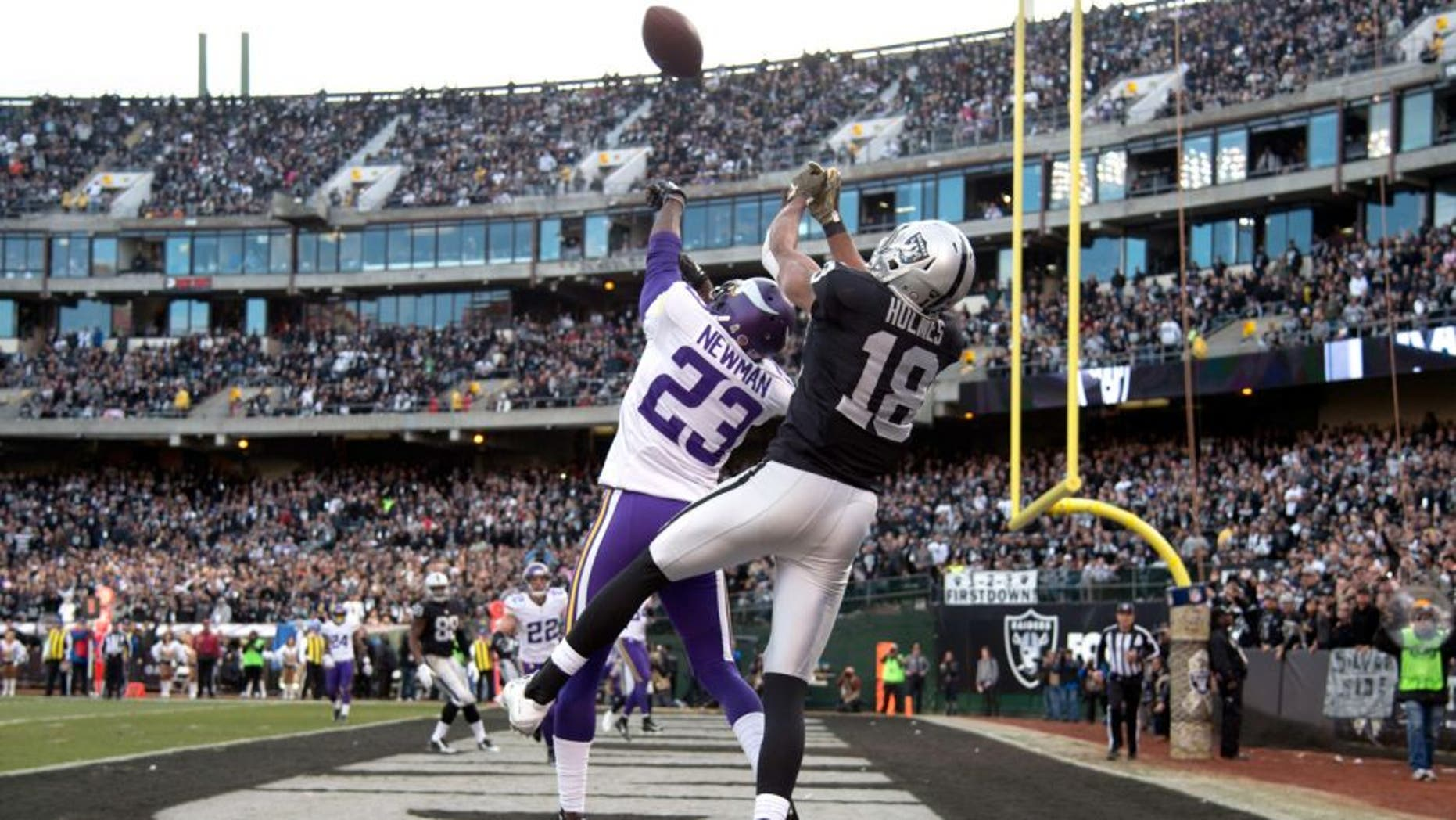 November 15, 2015; Oakland, CA, USA; Minnesota Vikings cornerback Terence Newman (23) intercepts the football intended for Oakland Raiders wide receiver Andre Holmes (18) during the fourth quarter at O.co Coliseum. The Vikings defeated the Raiders 30-14. Mandatory Credit: Kyle Terada-USA TODAY Sports