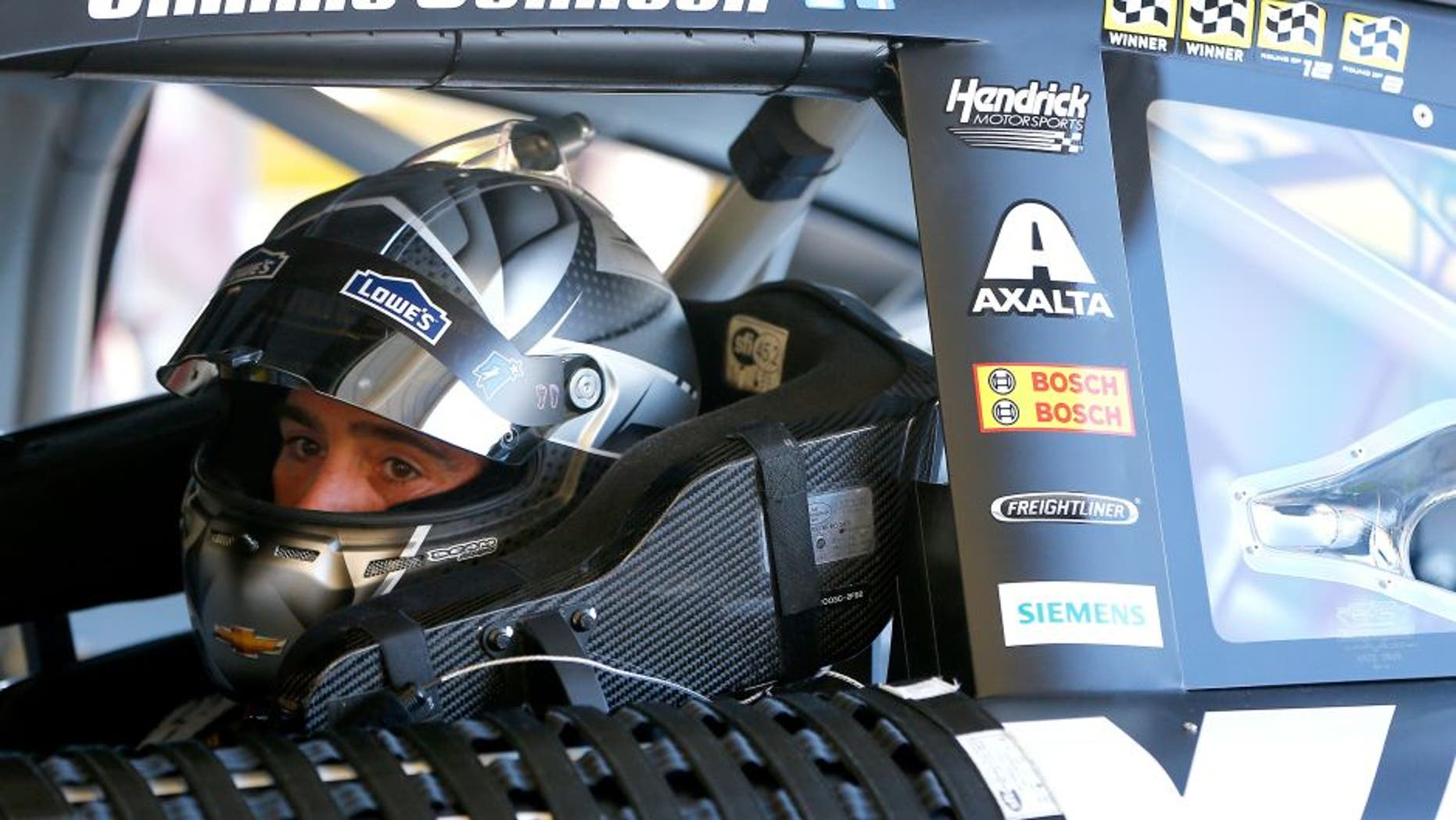 AVONDALE, AZ - NOVEMBER 11: Jimmie Johnson, driver of the #48 Kobalt Chevrolet, sits in his car during practice for the NASCAR Sprint Cup Series Can-Am 500 at Phoenix International Raceway on November 11, 2016 in Avondale, Arizona. (Photo by Jonathan Ferrey/Getty Images)