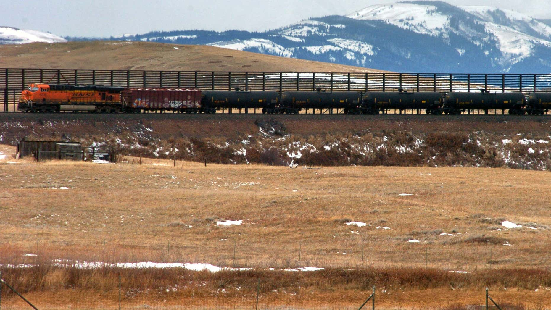 FIILE - In this Nov. 7, 2013, file photo, a train hauls oil into Glacier National Park near the Badger-Two Medicine National Forest in northwest Montana.