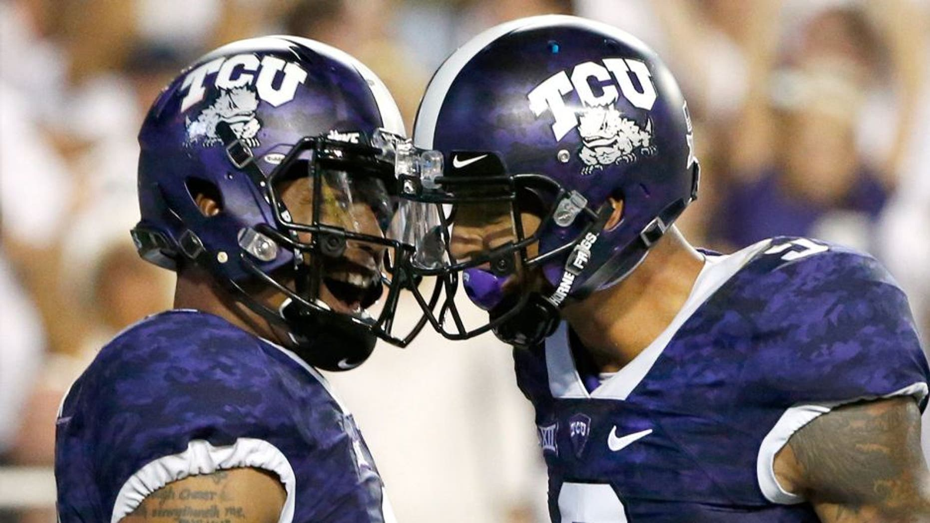 FORT WORTH, TX - SEPTEMBER 19: (L-R) Trevone Boykin #2 of the TCU Horned Frogs celebrates with teammate Josh Doctson #9 after Boykin scored on a touchdown run in the second quarter against the Southern Methodist Mustangs at Amon G. Carter Stadium on September 19, 2015 in Fort Worth, Texas. (Photo by Ron Jenkins/Getty Images)