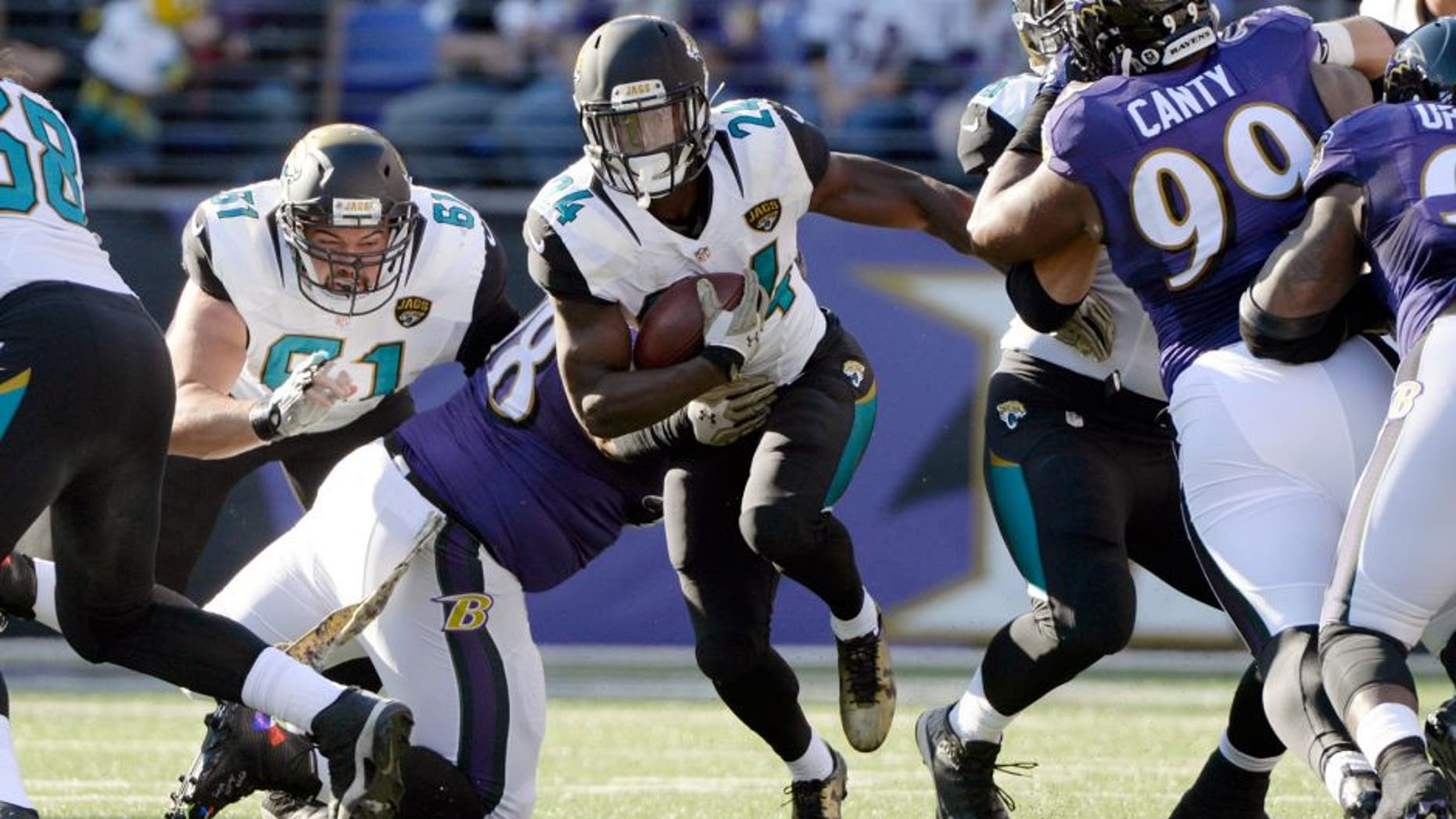 Nov 15, 2015; Baltimore, MD, USA; Jacksonville Jaguars running back T.J. Yeldon (24) runs during the first quarter against the Baltimore Ravens at M&T Bank Stadium. Mandatory Credit: Tommy Gilligan-USA TODAY Sports