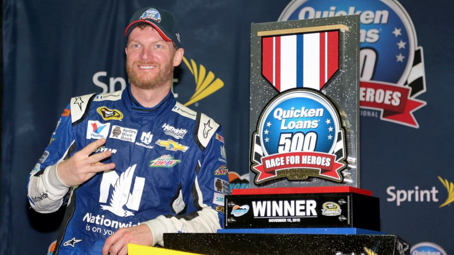 AVONDALE, AZ - NOVEMBER 15: Dale Earnhardt Jr., driver of the #88 Nationwide Chevrolet, celebrates in victory lane after winning the rain-shortened NASCAR Sprint Cup Series Quicken Loans Race for Heroes 500 at Phoenix International Raceway on November 15, 2015 in Avondale, Arizona. (Photo by Matt Sullivan/NASCAR via Getty Images)