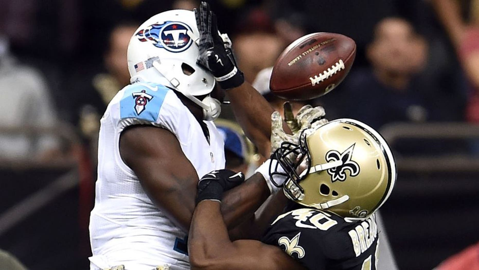 NEW ORLEANS, LA - NOVEMBER 08: Delvin Breaux #40 of the New Orleans Saints defends a pass intended for Dorial Green-Beckham #17 of the Tennessee Titans during a game at the Mercedes-Benz Superdome on November 8, 2015 in New Orleans, Louisiana. The Titans won the game in overtime 34-28. (Photo by Stacy Revere/Getty Images)