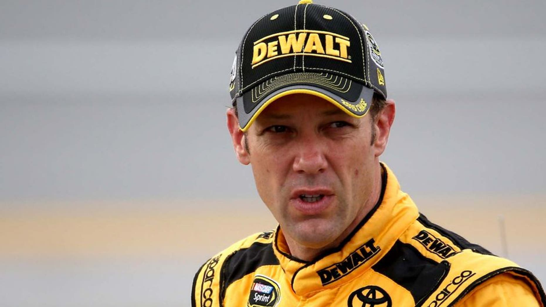 TALLADEGA, AL - OCTOBER 24: Matt Kenseth, driver of the #20 DeWalt Toyota, stands on the grid during qualifying for the NASCAR Sprint Cup Series CampingWorld.com 500 at Talladega Superspeedway on October 24, 2015 in Talladega, Alabama. (Photo by Chris Graythen/NASCAR via Getty Images)