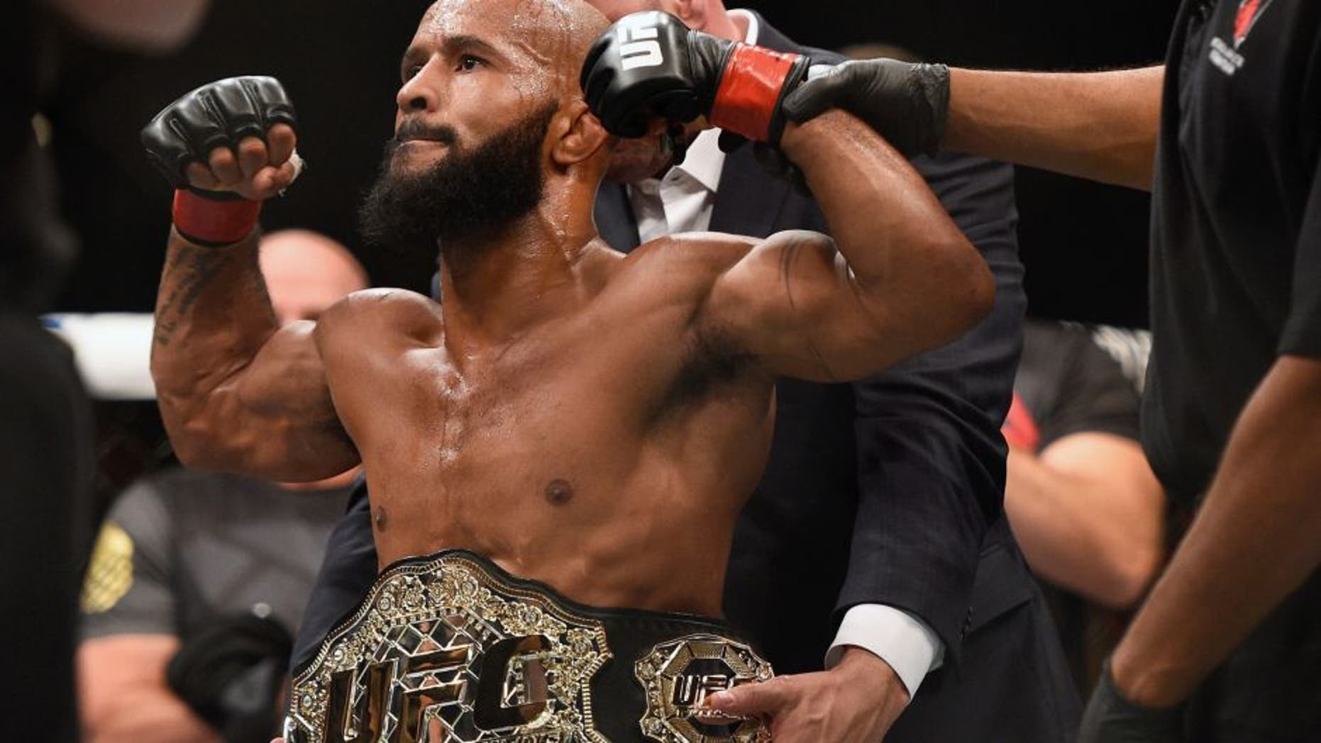 LAS VEGAS, NV - SEPTEMBER 05: Demetrious Johnson reacts after his victory over John Dodson in their flyweight championship bout during the UFC 191 event inside MGM Grand Garden Arena on September 5, 2015 in Las Vegas, Nevada. (Photo by Jeff Bottari/Zuffa LLC/Zuffa LLC via Getty Images)