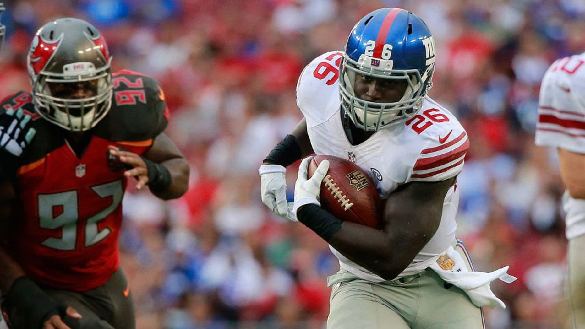 Nov 8, 2015; Tampa, FL, USA; New York Giants running back Orleans Darkwa (26) runs with the ball against the Tampa Bay Buccaneers during the first half at Raymond James Stadium. Mandatory Credit: Kim Klement-USA TODAY Sports