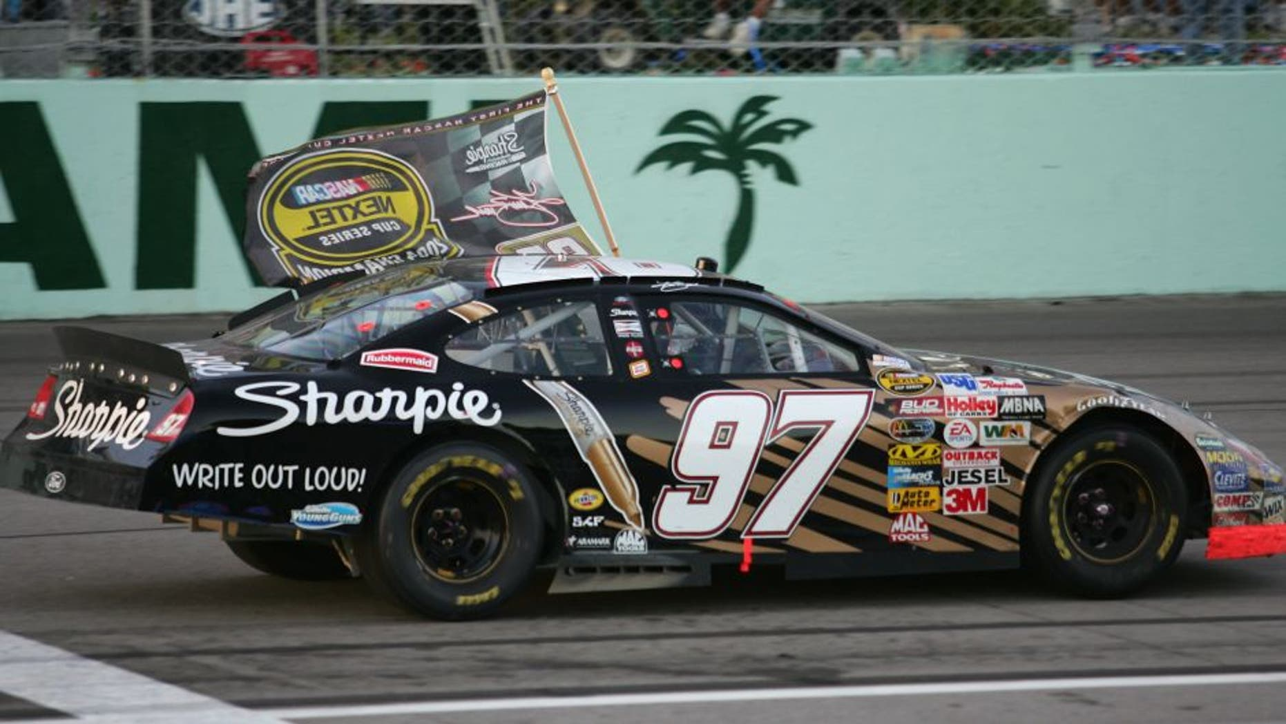 HOMESTEAD, FL - NOVEMBER 21: Kurt Busch, driver of the #97 Roush Racing Sharpie Ford, celebrates after winning the NASCAR Nextel Cup Series Championship at the Ford 400 on November 21, 2004 at the Homestead Miami Speedway in Homestead, Florida. (Photo by Robert Laberge/Getty Images)