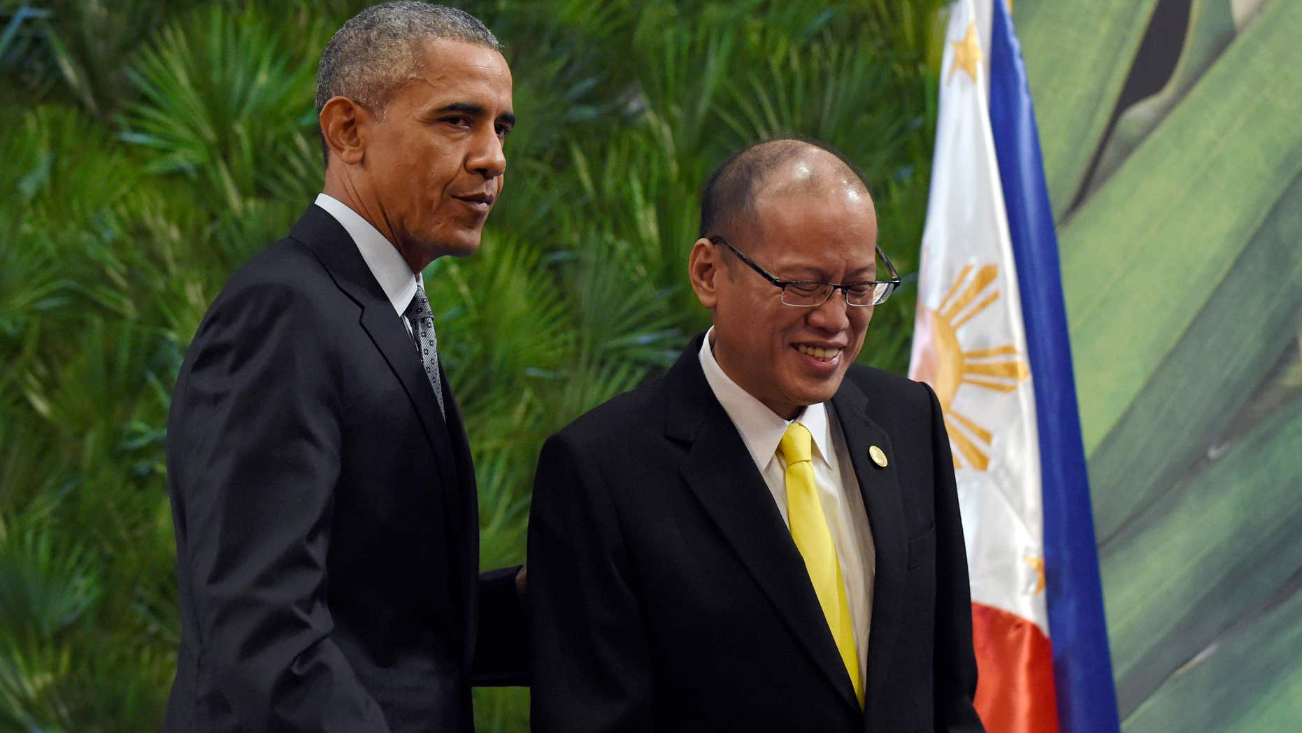Nov. 18, 2015: President Barack Obama, left, and Philippines' President Benigno Aquino III, right, walk off of the stage after participating in a news conference in Manila, Philippines ahead of the start of the Asia-Pacific Economic Cooperation summit.