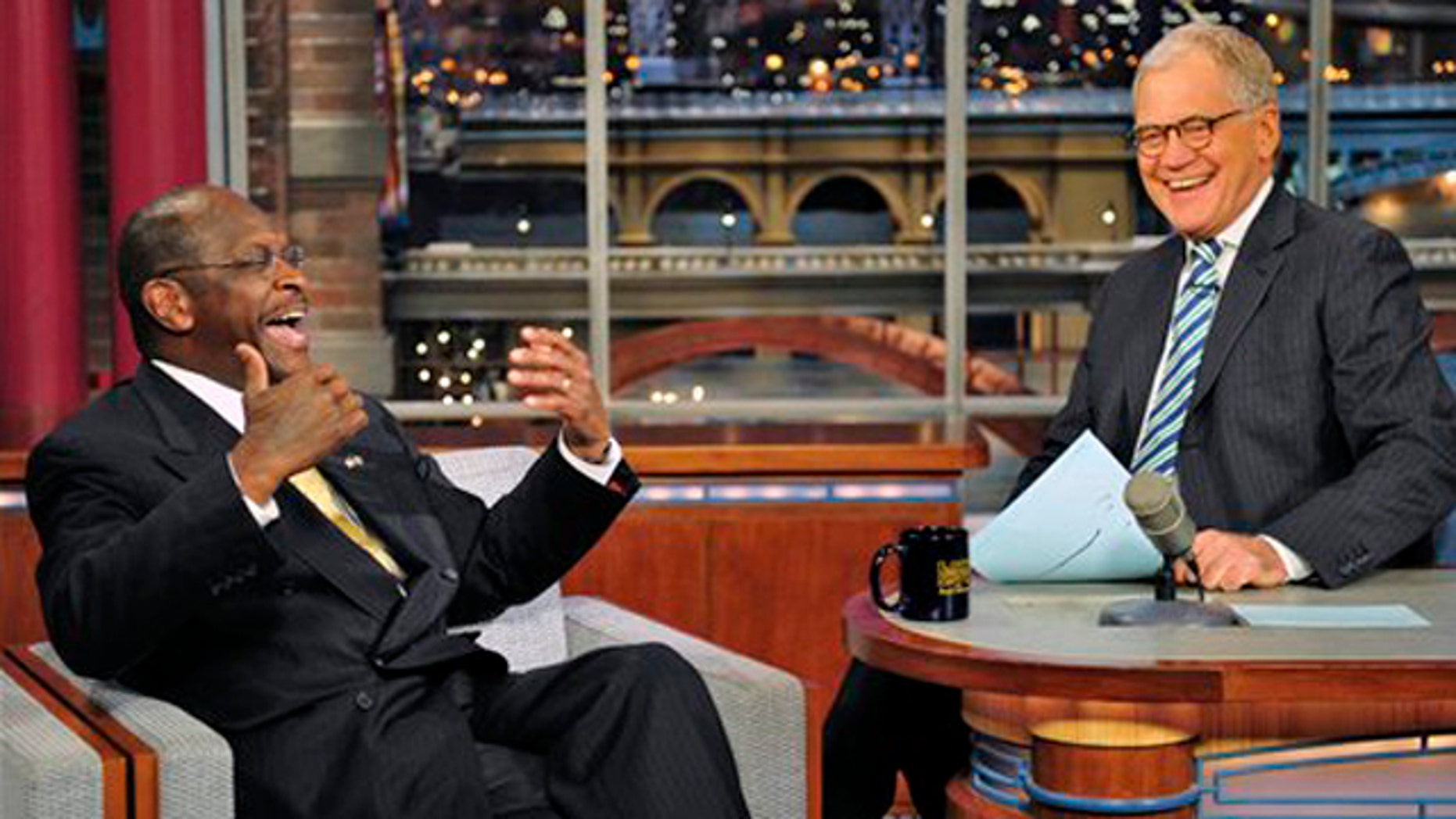 Novemeber 18, 2011:Republican presidential candidate Herman Cain joins host David Letterman on the set of the Late Show with David Letterman.