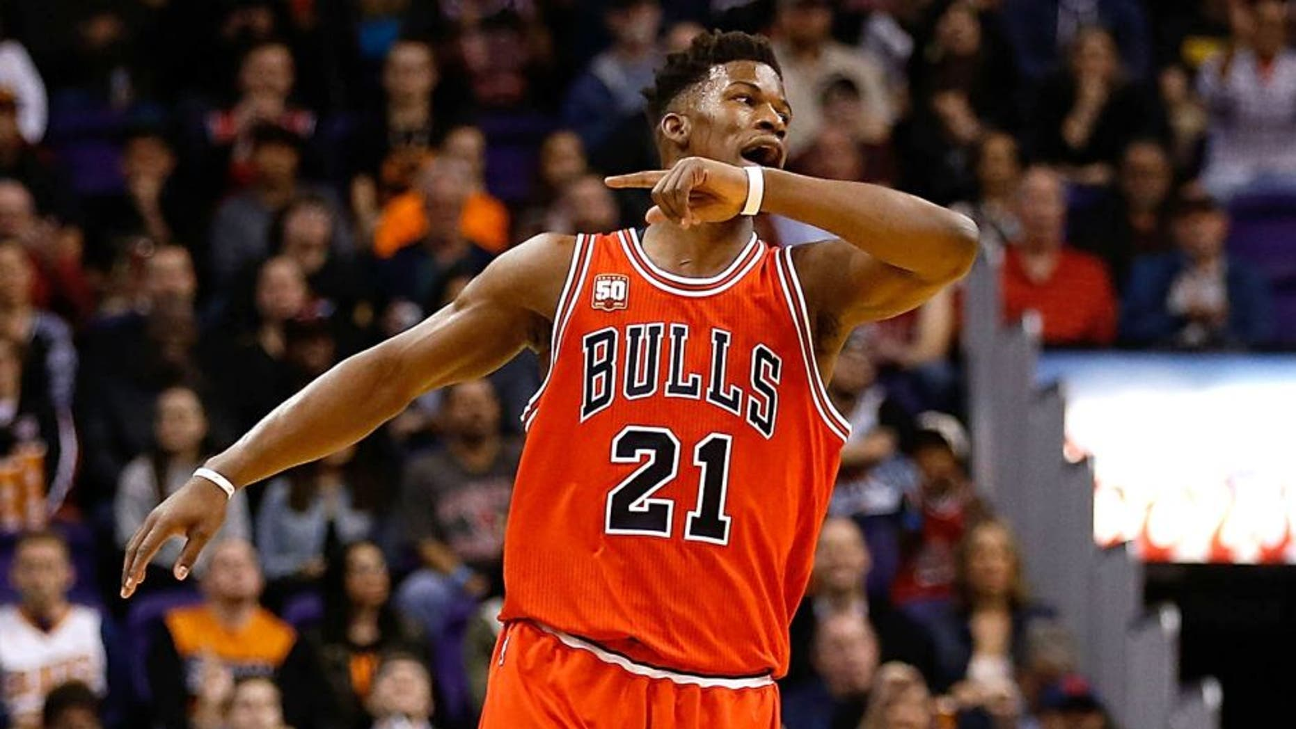 PHOENIX, AZ - NOVEMBER 18: Jimmy Butler #21 of the Chicago Bulls reacts after hitting a three point shot against the Phoenix Suns during the first half of the NBA game at Talking Stick Resort Arena on November 18, 2015 in Phoenix, Arizona. NOTE TO USER: User expressly acknowledges and agrees that, by downloading and or using this photograph, User is consenting to the terms and conditions of the Getty Images License Agreement. (Photo by Christian Petersen/Getty Images)
