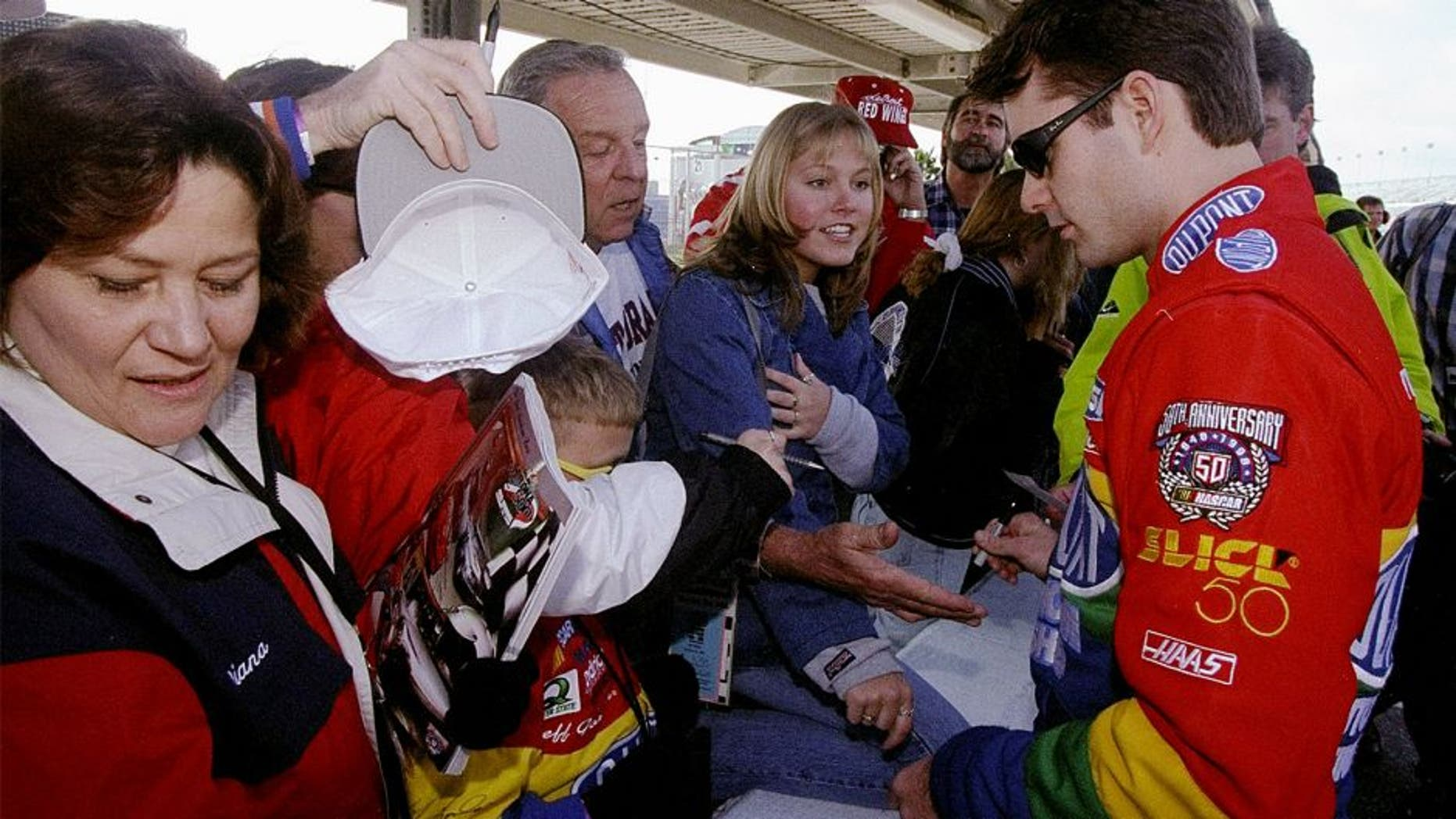 8 Feb 1998: Jeff Gordon signs autographs for fans during the Nascar Daytona 500 at the Daytona International Speedway in Daytona Beach, Florida. Mandatory Credit: David Taylor /Allsport