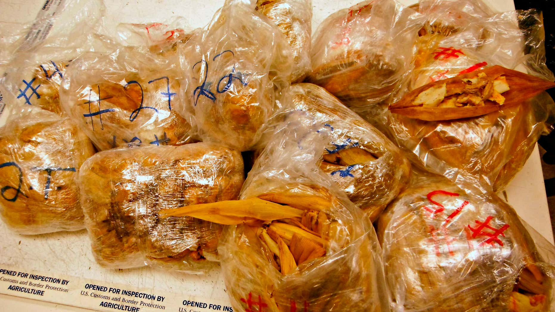 Nov. 2, 2015: This undated photo released by the U.S. Customs and Border Protection (CBP) shows seized 450 prohibited pork meat tamales discovered inside the luggage of a passenger arriving at the Los Angeles International Airport (LAX) from Mexico in Los Angeles.