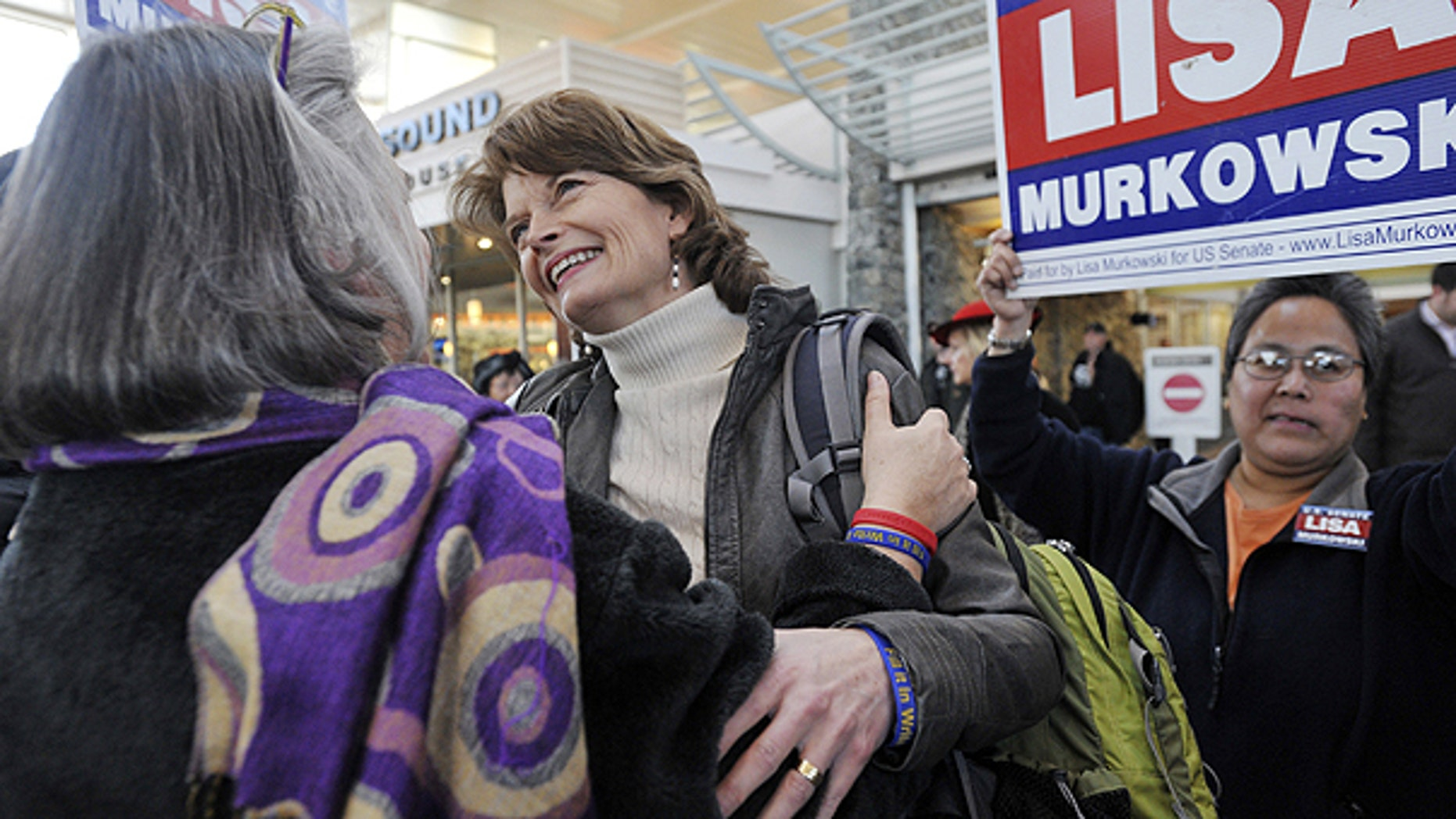 Nov. 17: U.S. Senator Lisa Murkowski (R) Alaska, center, is greeted by her sister Carol Sturgelewski, left, upon her arrival at Ted Stevens International Airport in Anchorage.