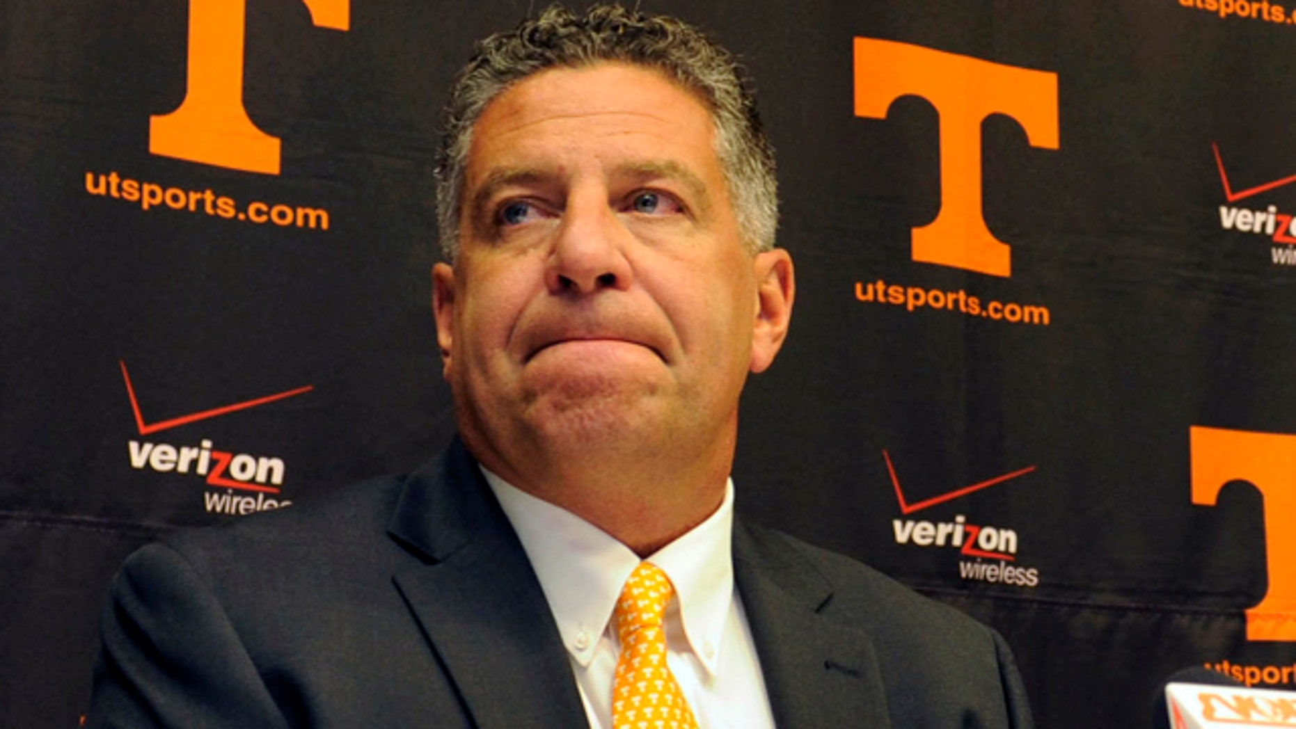 This Sept. 10, 2010, file photo shows University of Tennessee men's basketball coach Bruce Pearl grimacing during a news conference, where  Pearl expresses remorse for giving misleading information to the NCAA during an investigation into the school's basketball program, in Knoxville, Tenn.