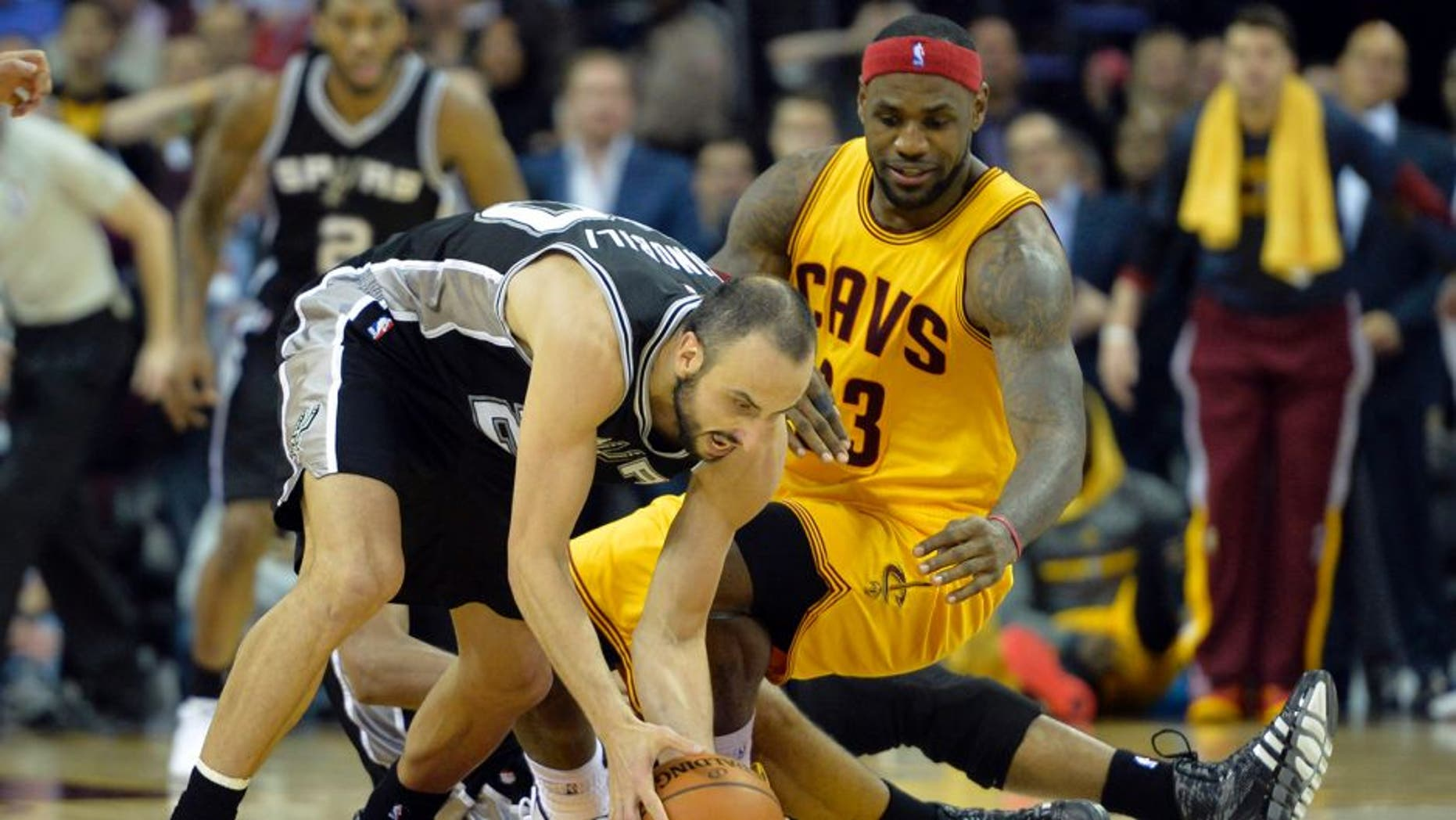 Nov 19, 2014; Cleveland, OH, USA; Cleveland Cavaliers forward LeBron James (23) watches after losing the ball to San Antonio Spurs guard Manu Ginobili (20) in the final seconds at Quicken Loans Arena. Mandatory Credit: David Richard-USA TODAY Sports