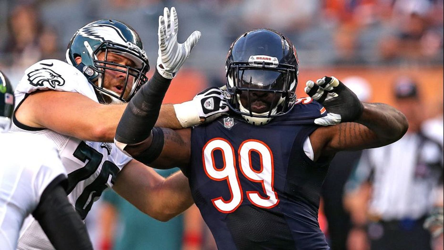 CHICAGO, IL - AUGUST 08: Lamarr Houston #99 of the Chicago Bears rushes against Allen Barbre #76 of the Philadelphia Eagles during a preseason game at Soldier Field on August 8, 2014 in Chicago, Illinois. (Photo by Jonathan Daniel/Getty Images) *** Local Caption *** Lamarr Houston; Allen Barbre