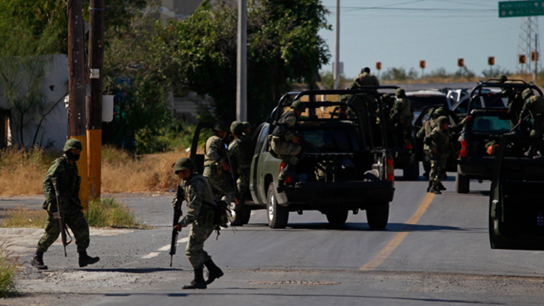 Nov. 19: Soldiers prepare to leave after inspecting a house in Ciudad Mier, Mexico.