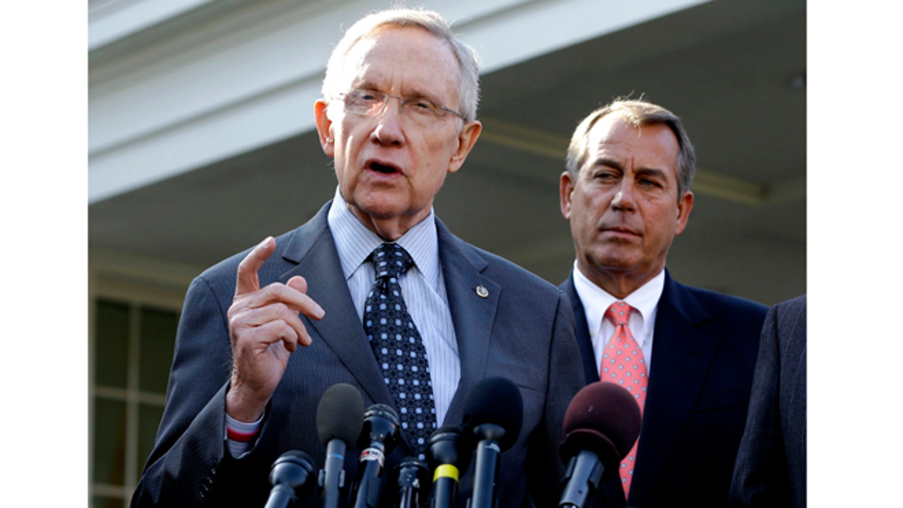 Nov. 16, 2012: Senate Majority Leader Harry Reid of Nev., left, with House Speaker John Boehner of Ohio looking on, speaking to reporters outside the White House in Washington following a meeting with President Barack Obama to discuss the economy and the deficit.