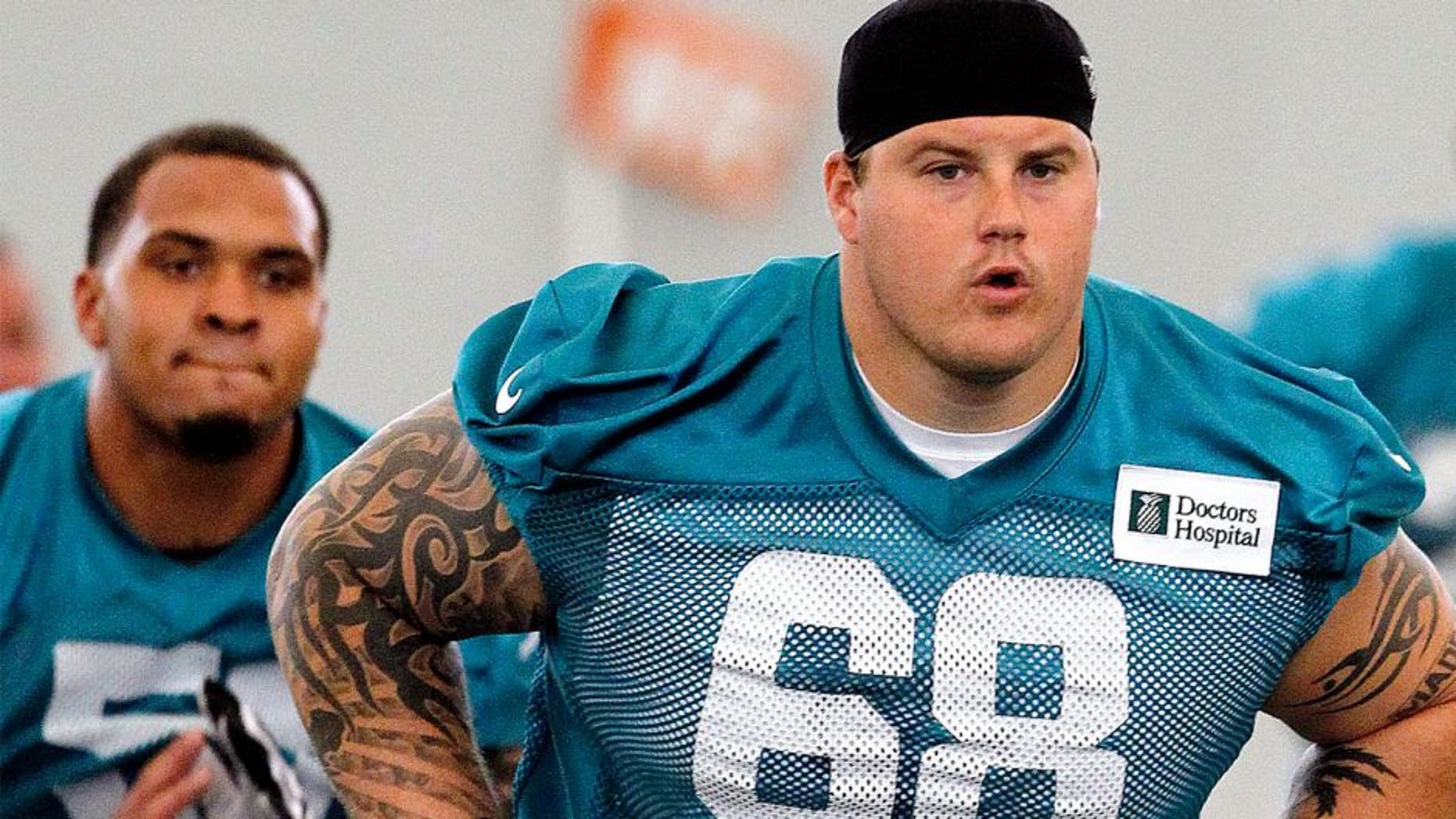 DAVIE, FL - MAY 21: Richie Incognito #68 of the Miami Dolphins runs a drill during the first team OTA on May 21, 2013 at the Miami Dolphins training facility in Davie, Florida. (Photo by Joel Auerbach/Getty Images)