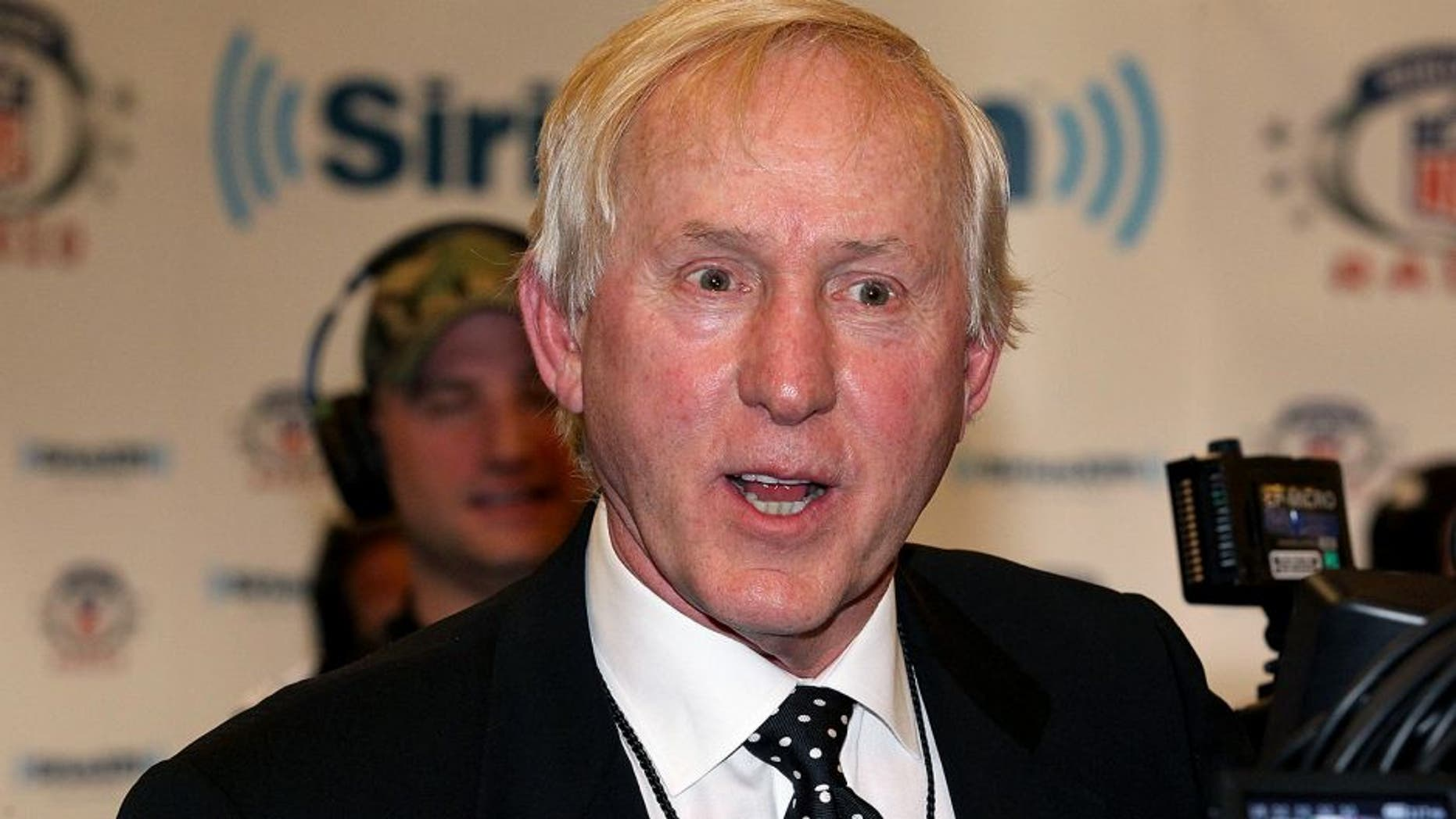 Feb 3, 2012; Indianapolis, IN, USA; NFL former quarterback Fran Tarkenton gives an interview on radio row for Super Bowl week. The New York Giants will play the New England Patriots in Super Bowl XLVI . Mandatory Credit: Matthew Emmons-USA TODAY Sports