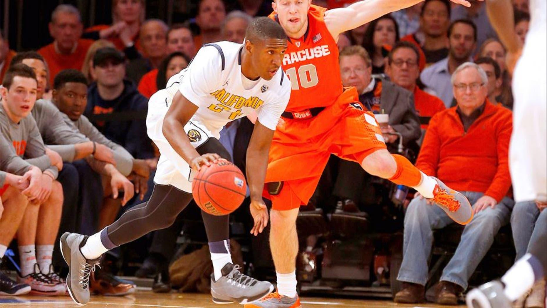 Nov 20, 2014; New York, NY, USA; California Golden Bears guard Jordan Mathews (24) works against Syracuse Orange guard Trevor Cooney (10) during the first half at Madison Square Garden. Mandatory Credit: Jim O'Connor-USA TODAY Sports